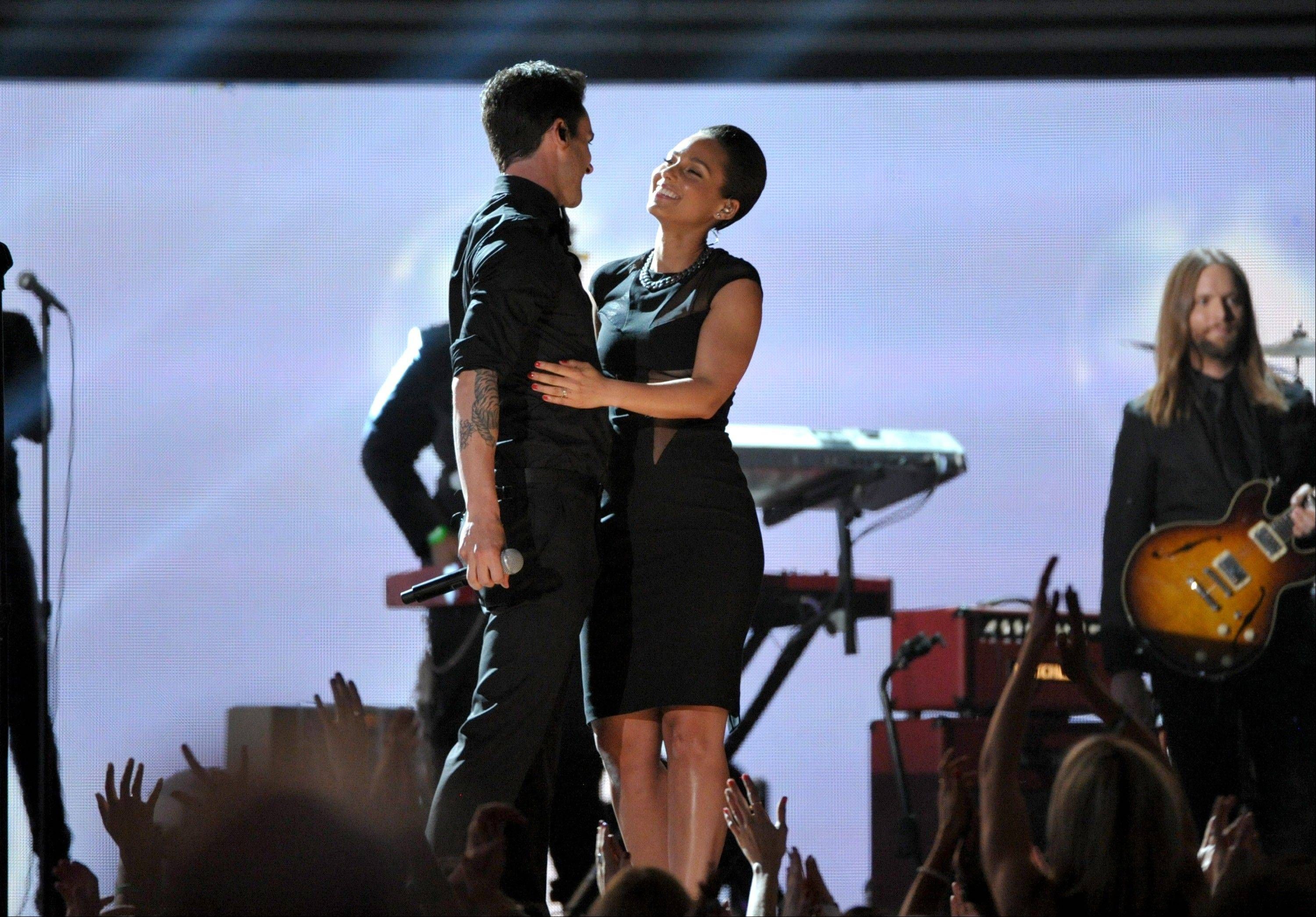 Adam Levine of Maroon 5, and Alicia Keys perform at the 55th annual Grammy Awards on Sunday, Feb. 10, 2013, in Los Angeles.