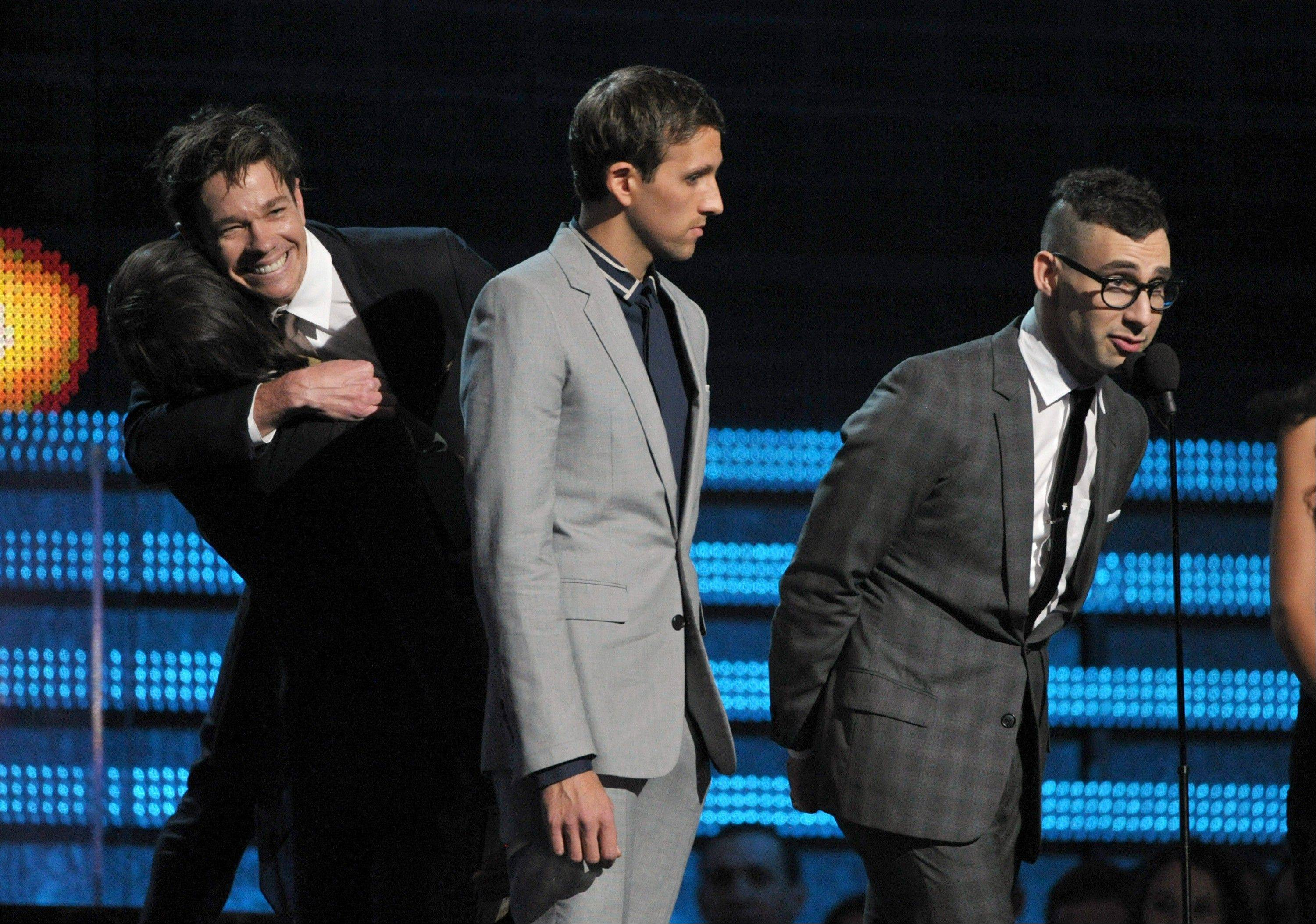 "From left, Jeff Bhasker, Nate Ruess, Andrew Dost and Jack Antonoff who make up the band Fun., accept the award for song of the year for ""We Are Young"" at the 55th annual Grammy Awards on Sunday, Feb. 10, 2013, in Los Angeles."