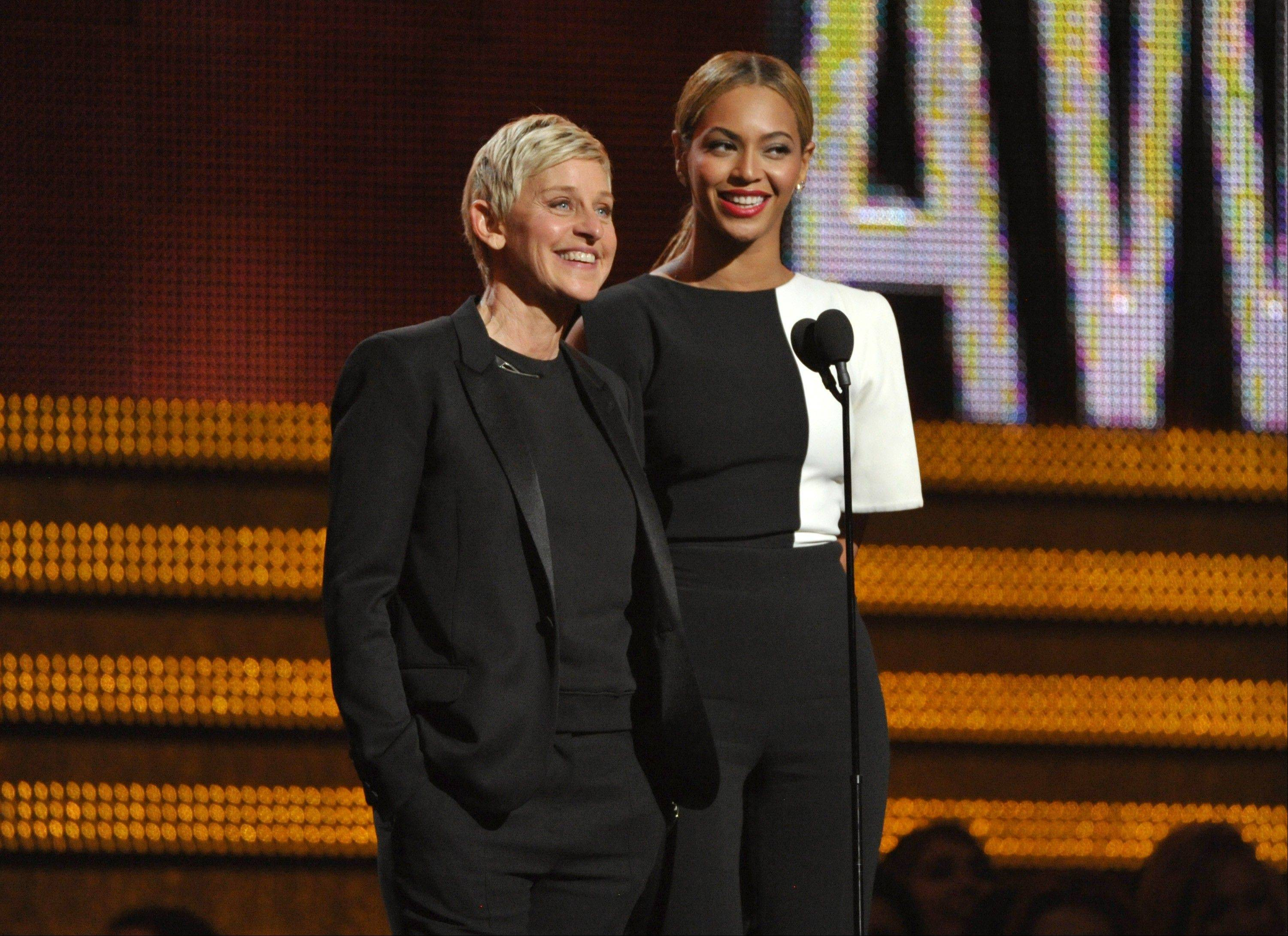 Ellen DeGeneres, left, and Beyonce speak on stage at the 55th annual Grammy Awards on Sunday, Feb. 10, 2013, in Los Angeles.
