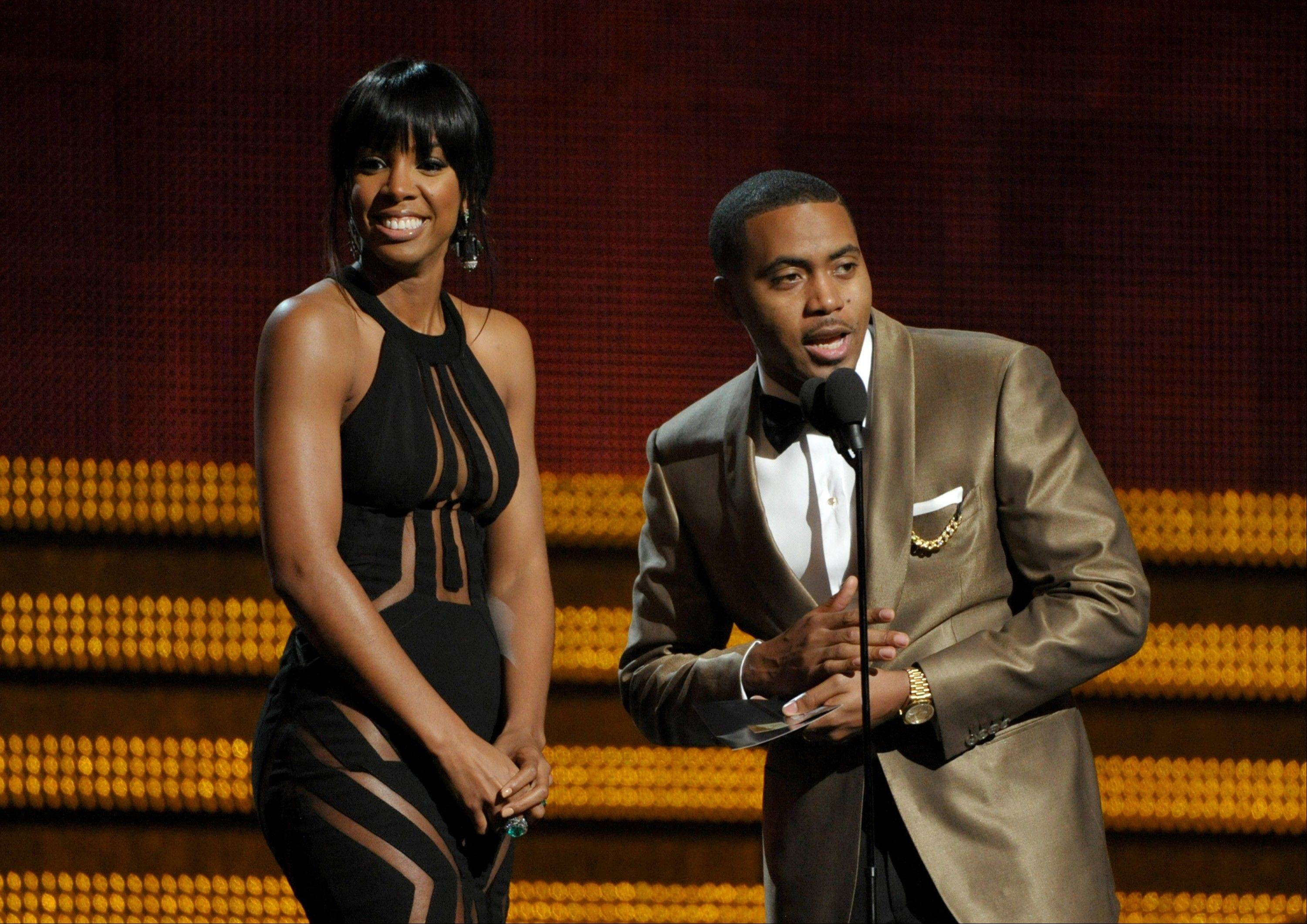 Kelly Rowland, left, and Nas present the award for best urban contemporary album at the 55th annual Grammy Awards on Sunday, Feb. 10, 2013, in Los Angeles.