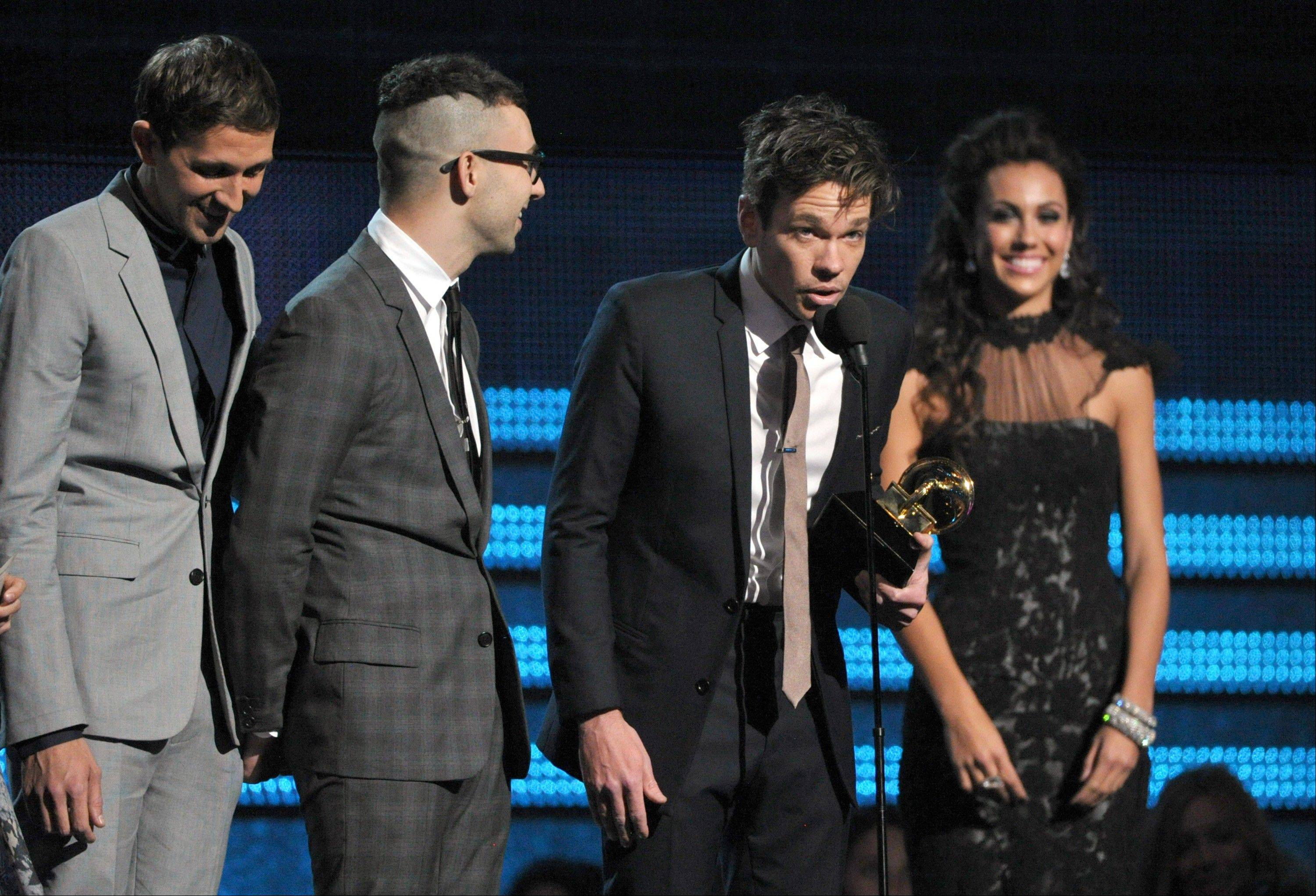 "Members of fun., from left, Andrew Dost, Jack Antonoff and Nate Ruess accept the award for song of the year for ""We Are Young"" at the 55th annual Grammy Awards on Sunday, Feb. 10, 2013, in Los Angeles."