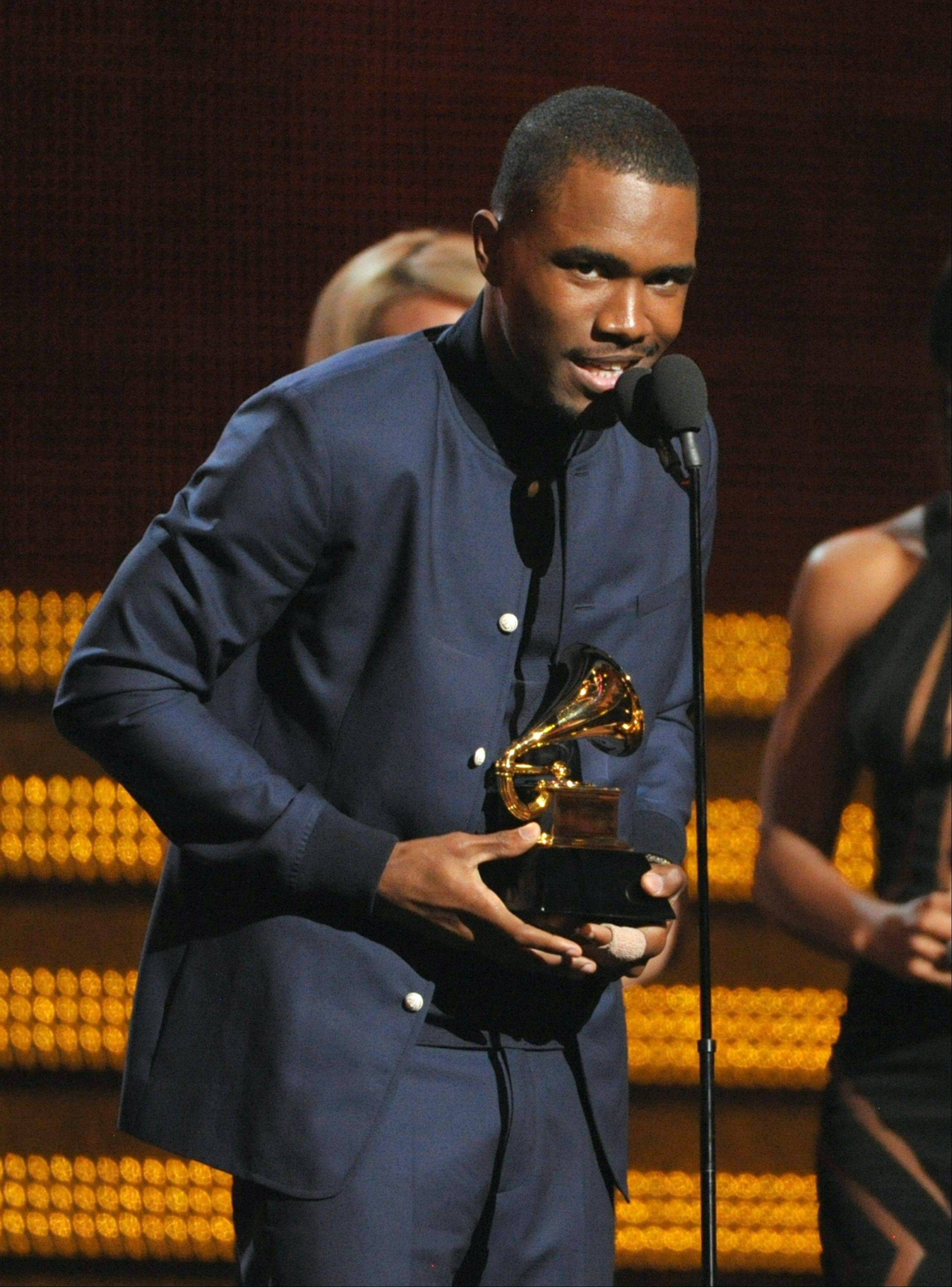Frank Ocean accepts the award for best urban contemporary album at the 55th annual Grammy Awards on Sunday, Feb. 10, 2013, in Los Angeles.