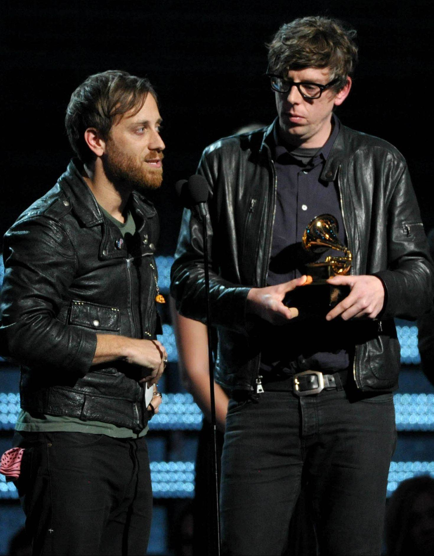 "Dan Auerbach, left, and Patrick Carney of the Black Keys accept the award for best rock performance for ""Lonely Boy"" Sunday in Los Angeles. Auerbach would end up with four Grammys."
