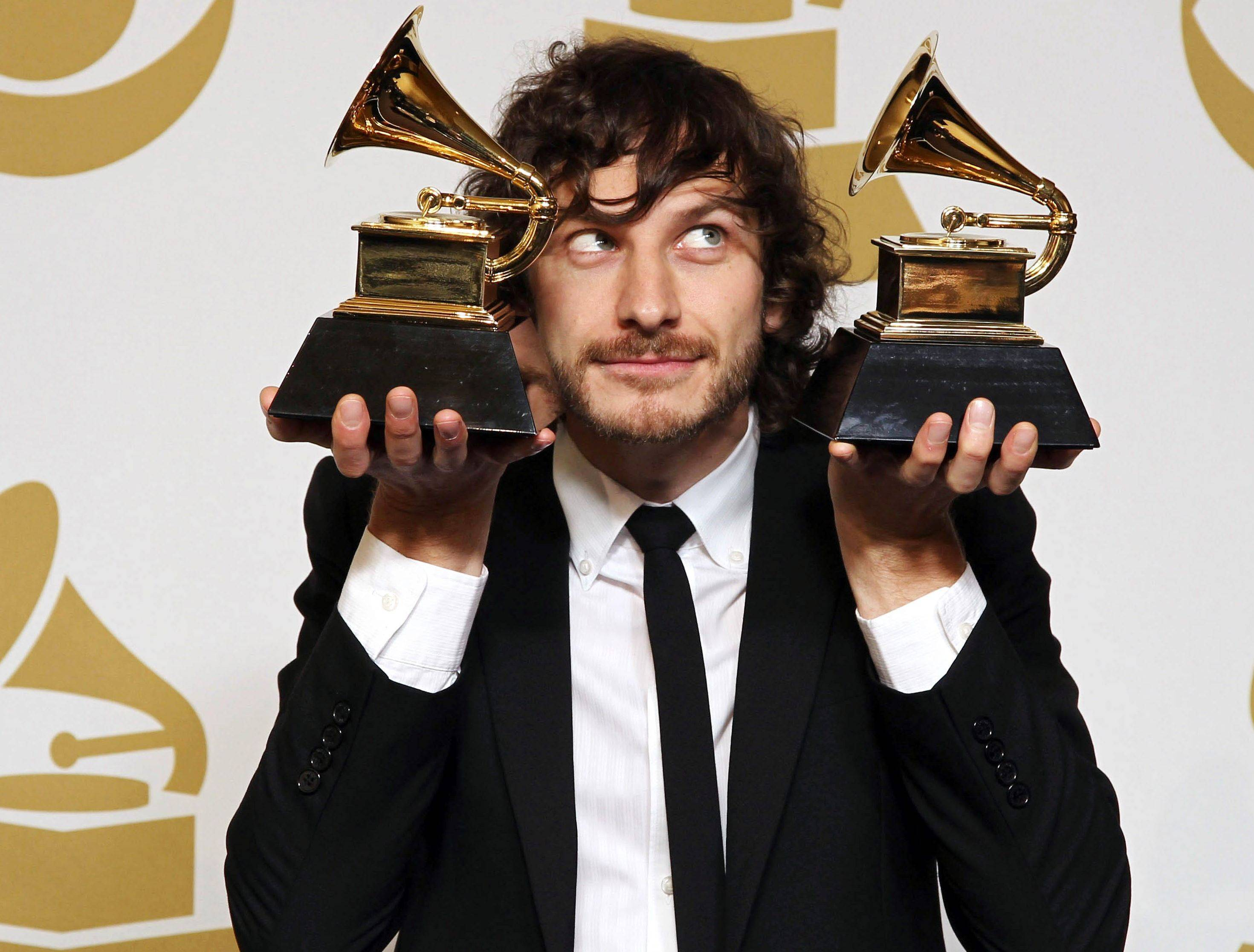 "Gotye poses backstage with the awards for best pop duo/group performance for ""Somebody That I Used to Know"" and best alternative music album for ""Making Mirrors."""