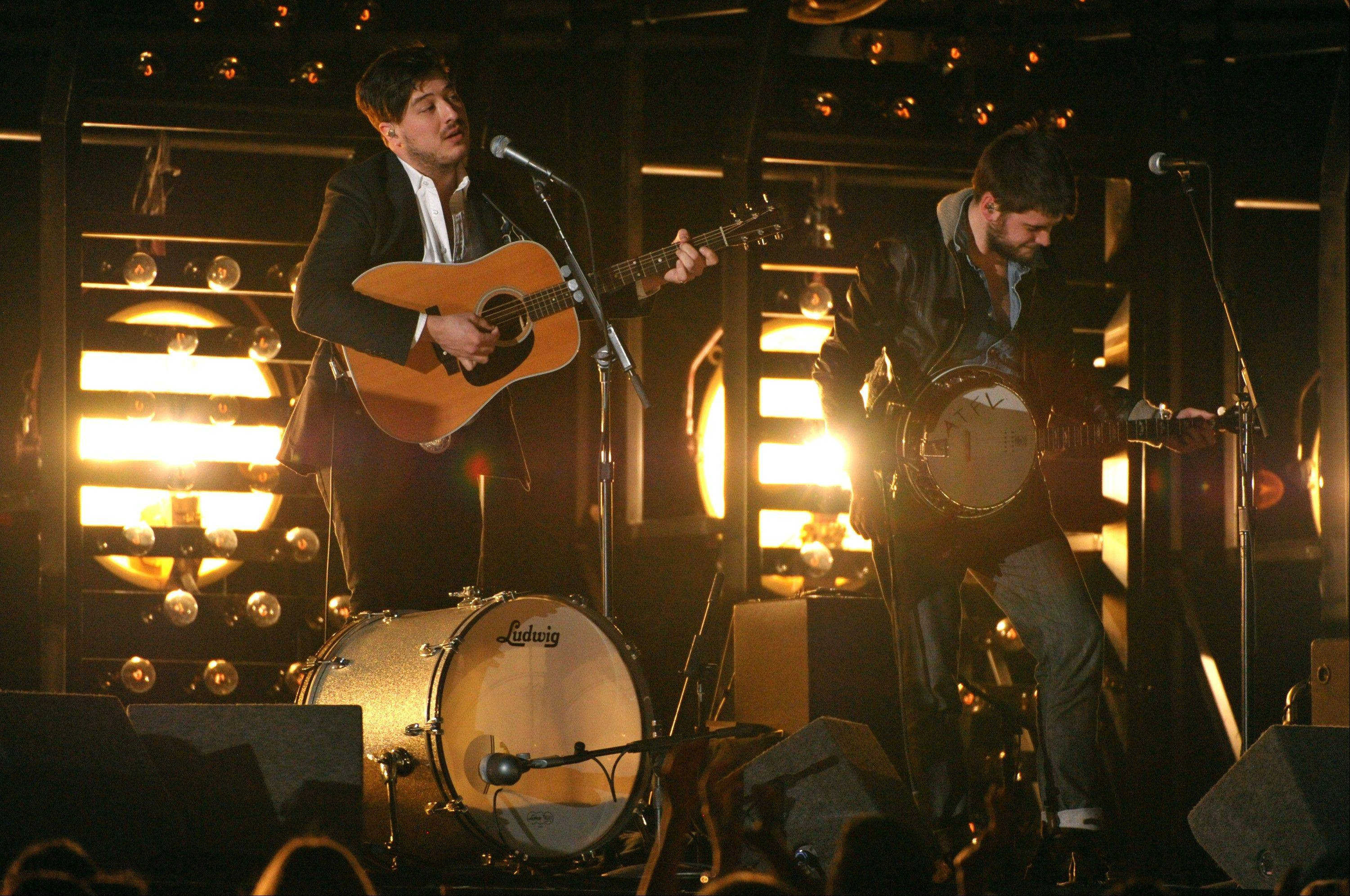 Marcus Mumford, left, and Winston Marshall, of Mumford & Sons, perform at the 55th annual Grammy Awards on Sunday in Los Angeles. The band took home the coveted album of the year award.