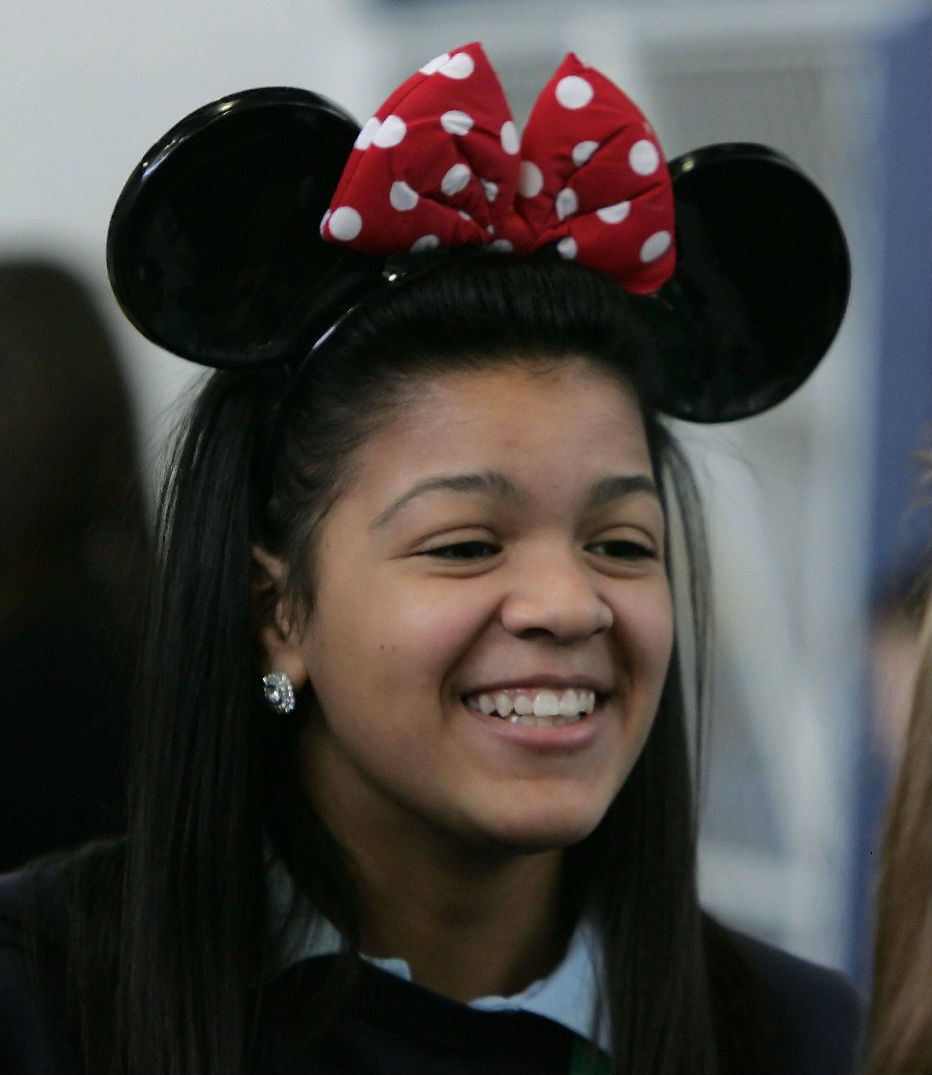Deandre Butler wears Minnie Mouse ears to reflect her project on Walt Disney World during the Academic Fair Wednesday at St. Patrick Catholic School in Wadsworth.