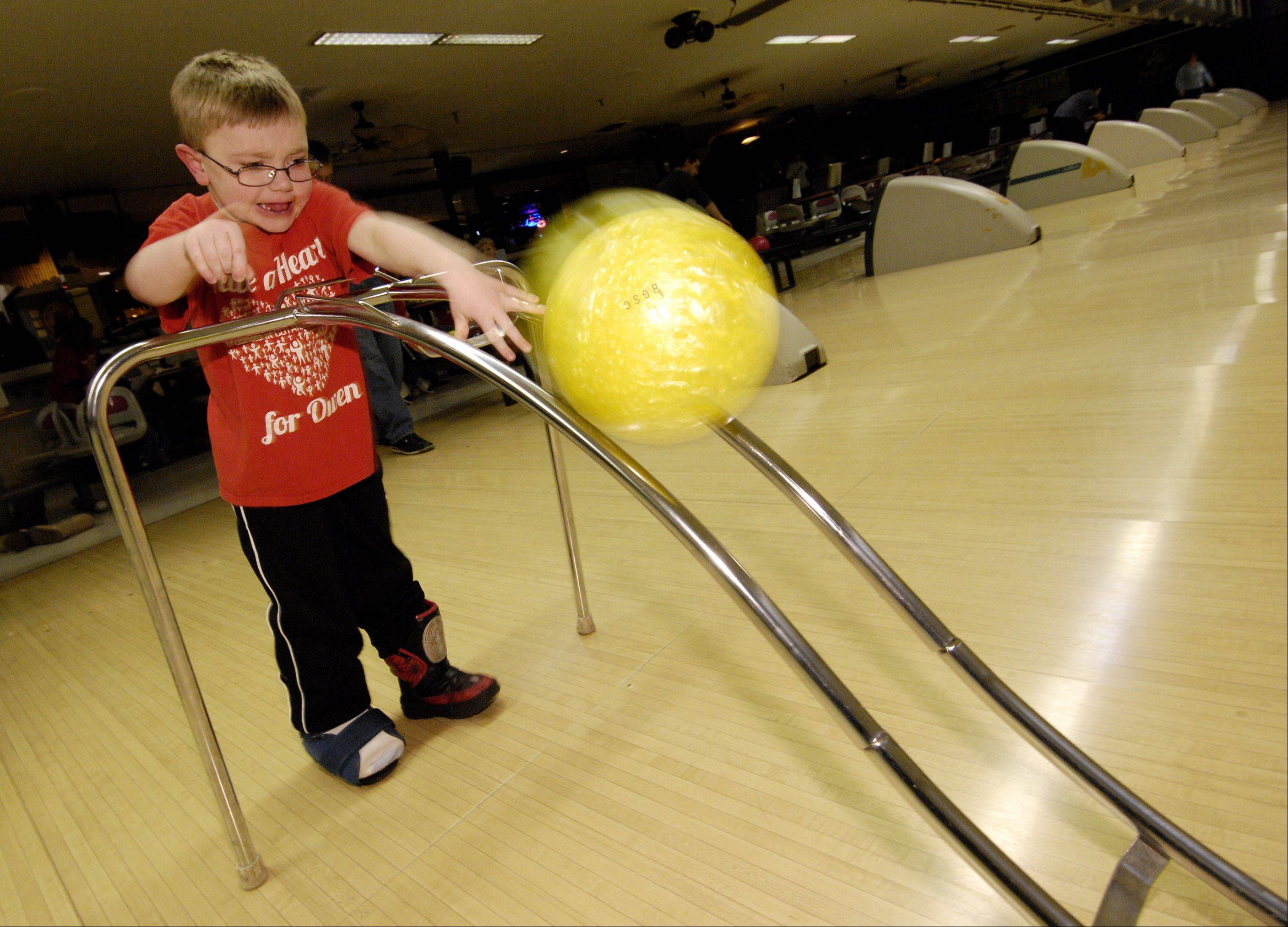 Owen Payton, 6, of West Chicago, bowls during the Children's Organ Transplant Association's Have a Heart for Owen bowling fundraiser at Bowling Green Sports Center Sunday. Payton, who was born with a congenital heart defect, is in need of a heart transplant.
