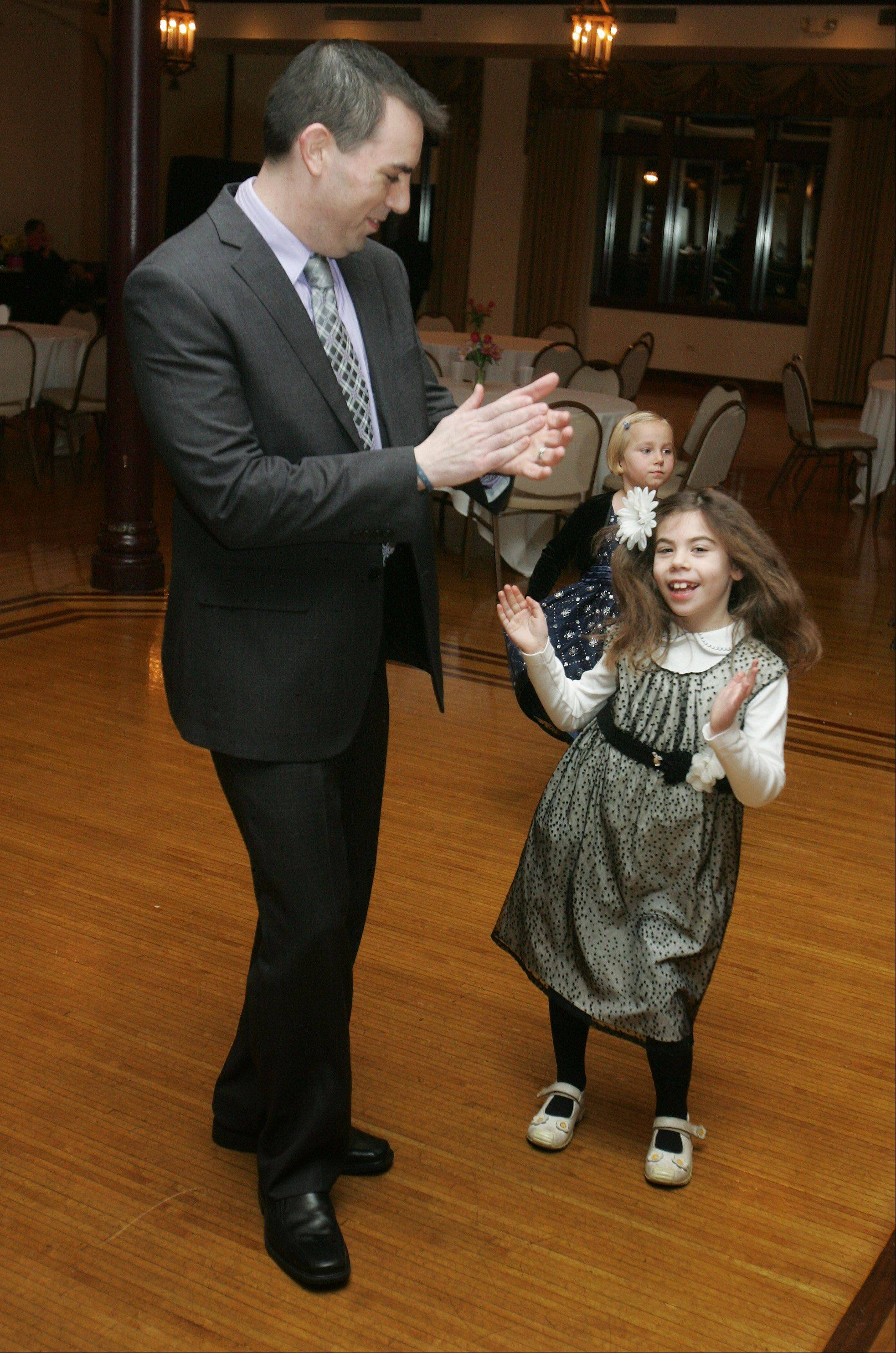 Zoey Perlman, 7, of Buffalo Grove, dances with her father, Sean, during the Valentine's Dance Sunday at the Chevy Chase Country Club in Wheeling. Raising Up Our Angels sweetheart dance was sponsored by the Kiski Valley Veterans and Patriots Association to support the Wounded Warrior Project.