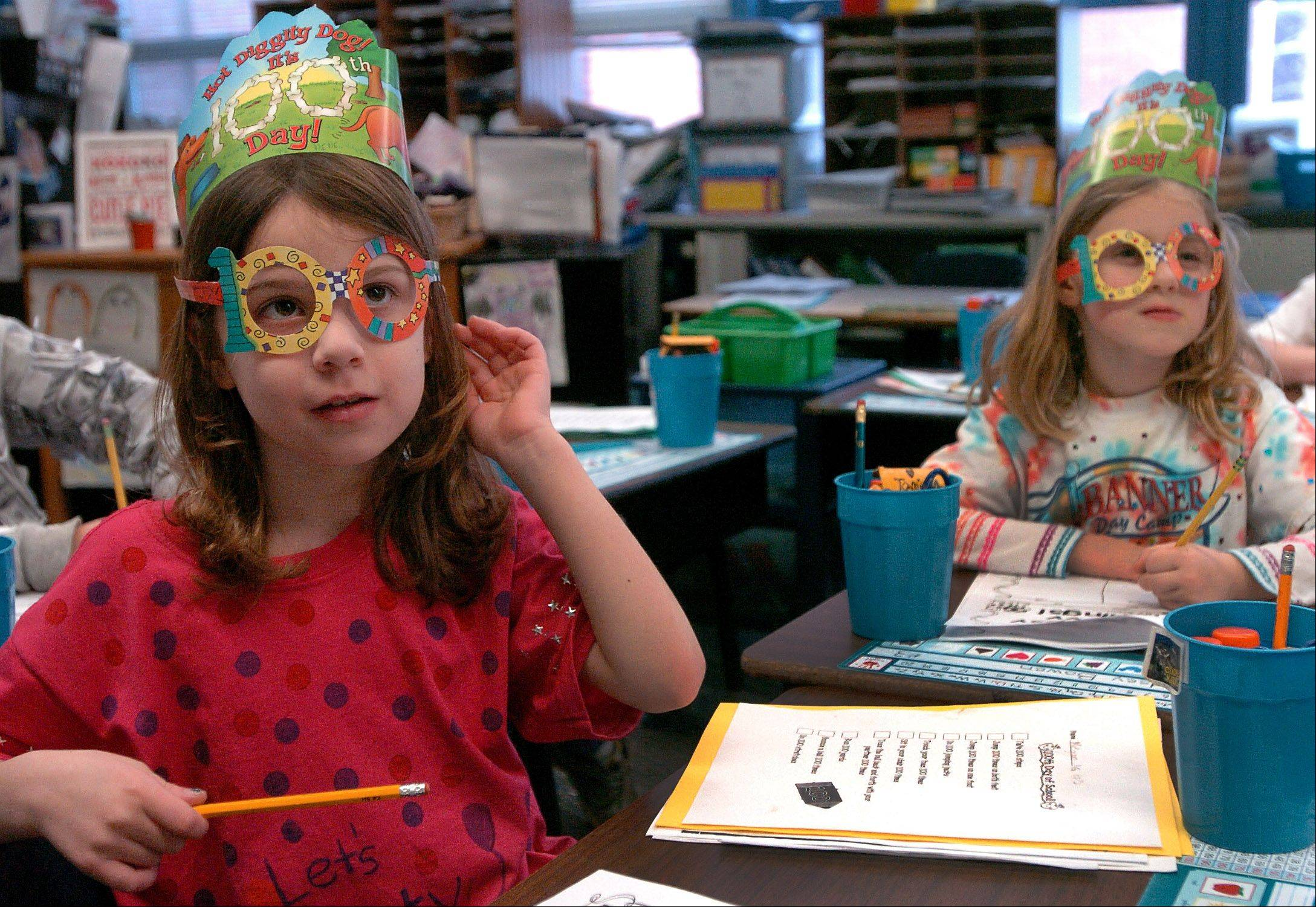 Megan Blakeman, left, and Tami Mitchell try to think of 100 Topsy Turvy words during Copeland Manor School celebration of the 100th day of school.