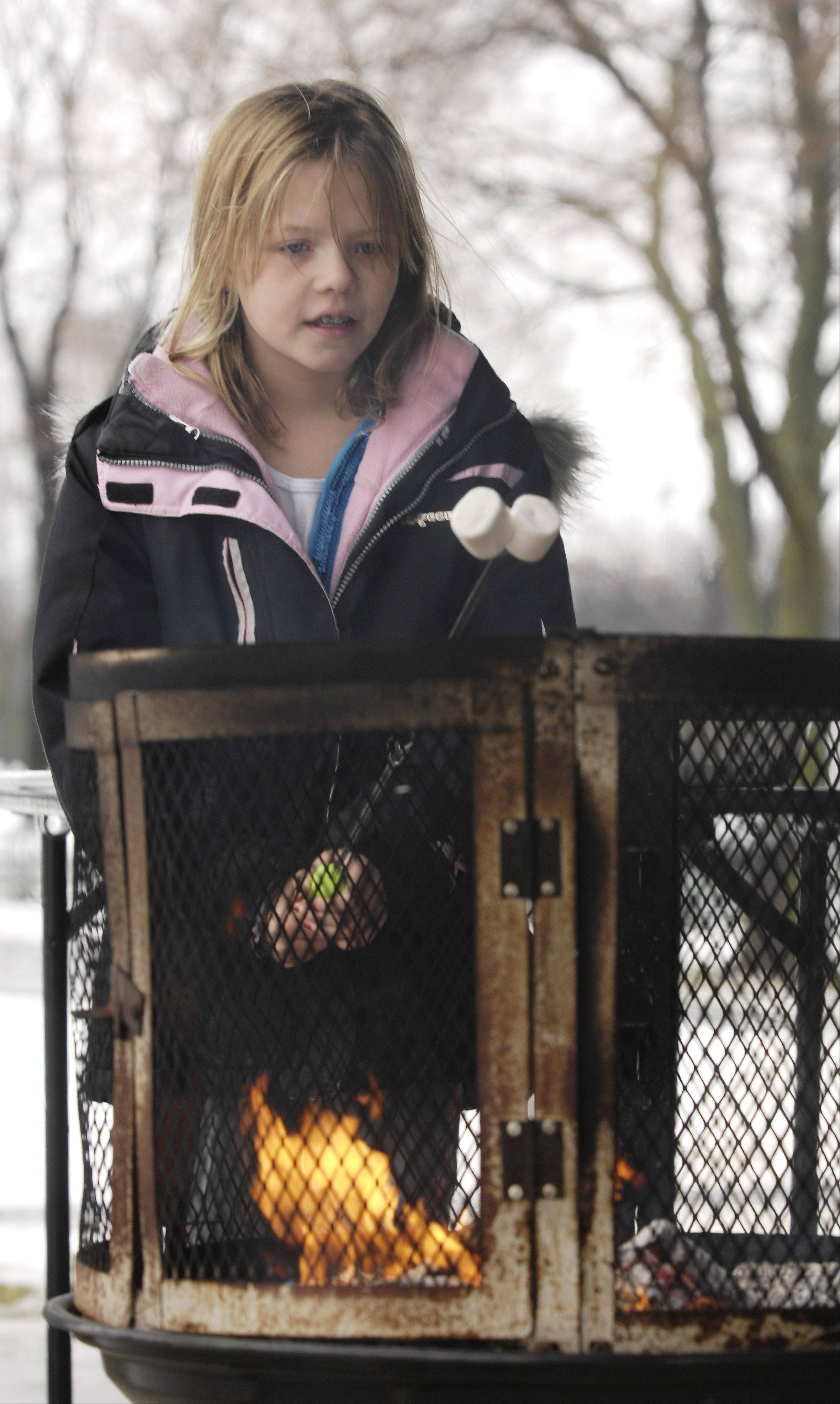 Stephanie Haiden, 10, of Hinsdale makes some smores Sunday during the Oak Brook Park District and Oak Brook Civic Association's annual Winterfest at Central Park West.
