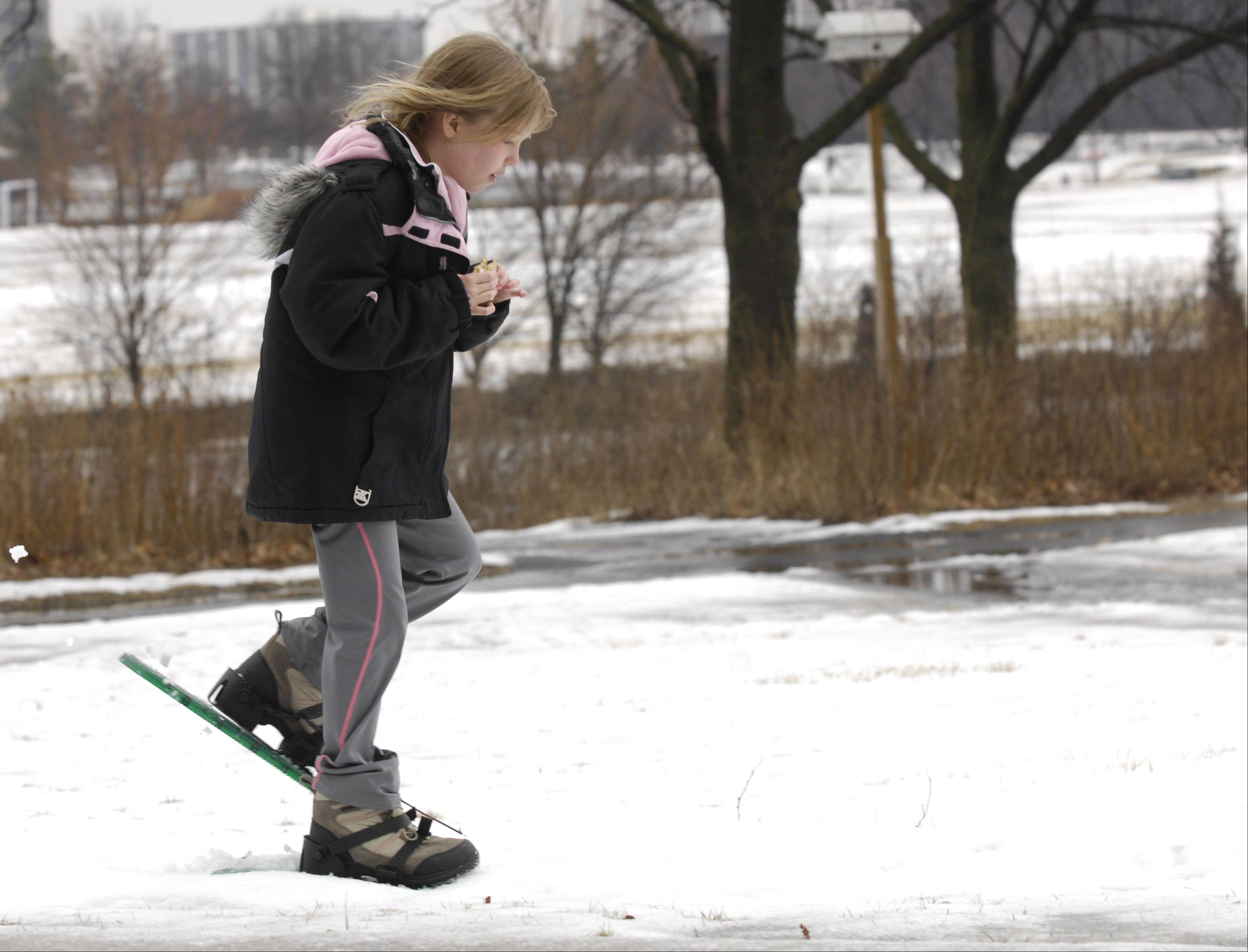 Stephanie Haiden, 10, of Hinsdale tries snowshoeing Sunday during the Oak Brook Park District and Oak Brook Civic Association's annual Winterfest at Central Park West.