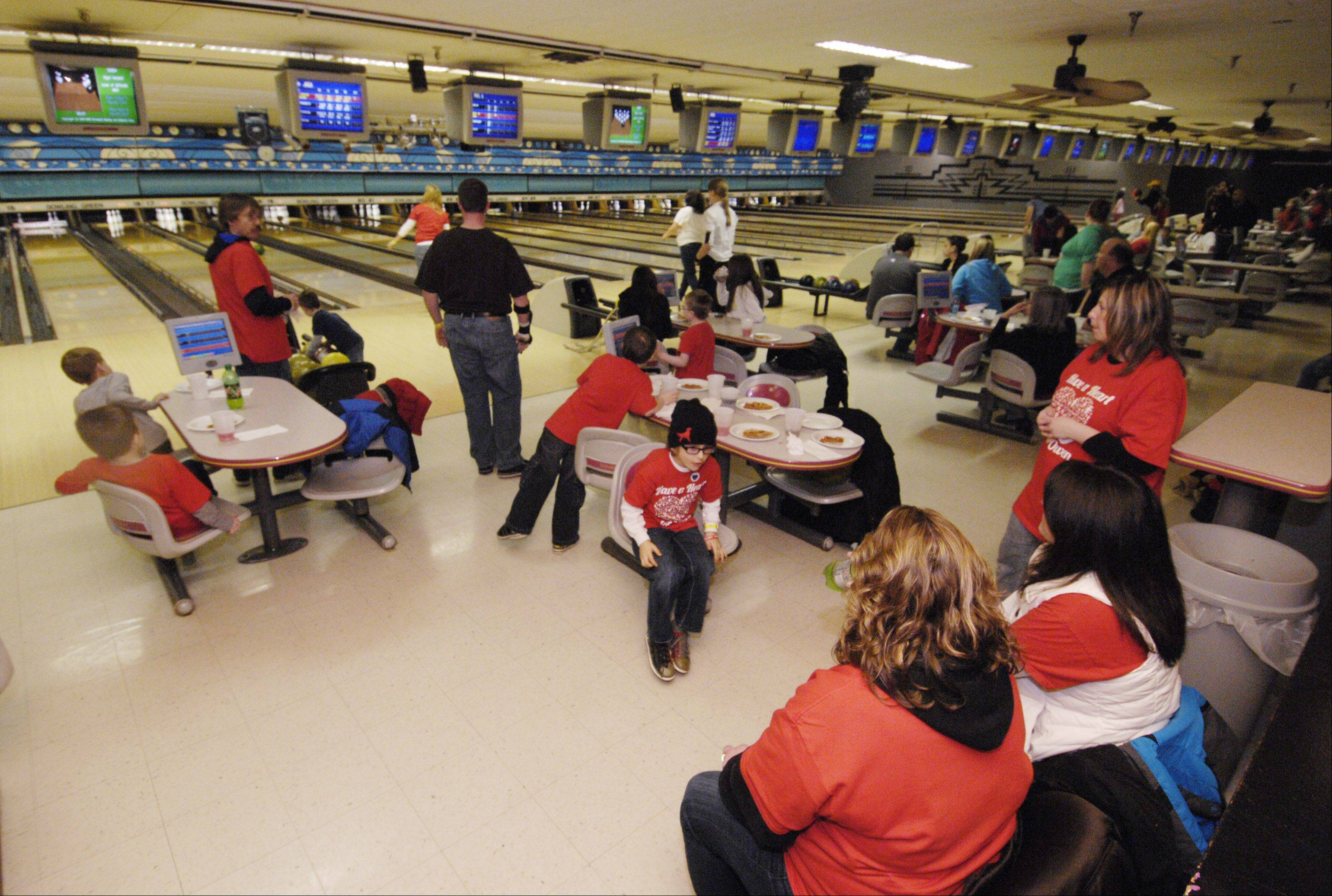 "The Children's Organ Transplant Association hosts the ""Have a Heart for Owen"" bowling fundraiser Sunday for Owen Payton, 6, of West Chicago, who is in need of a heart transplant. The fundraiser was held at the Bowling Green Sports Center."