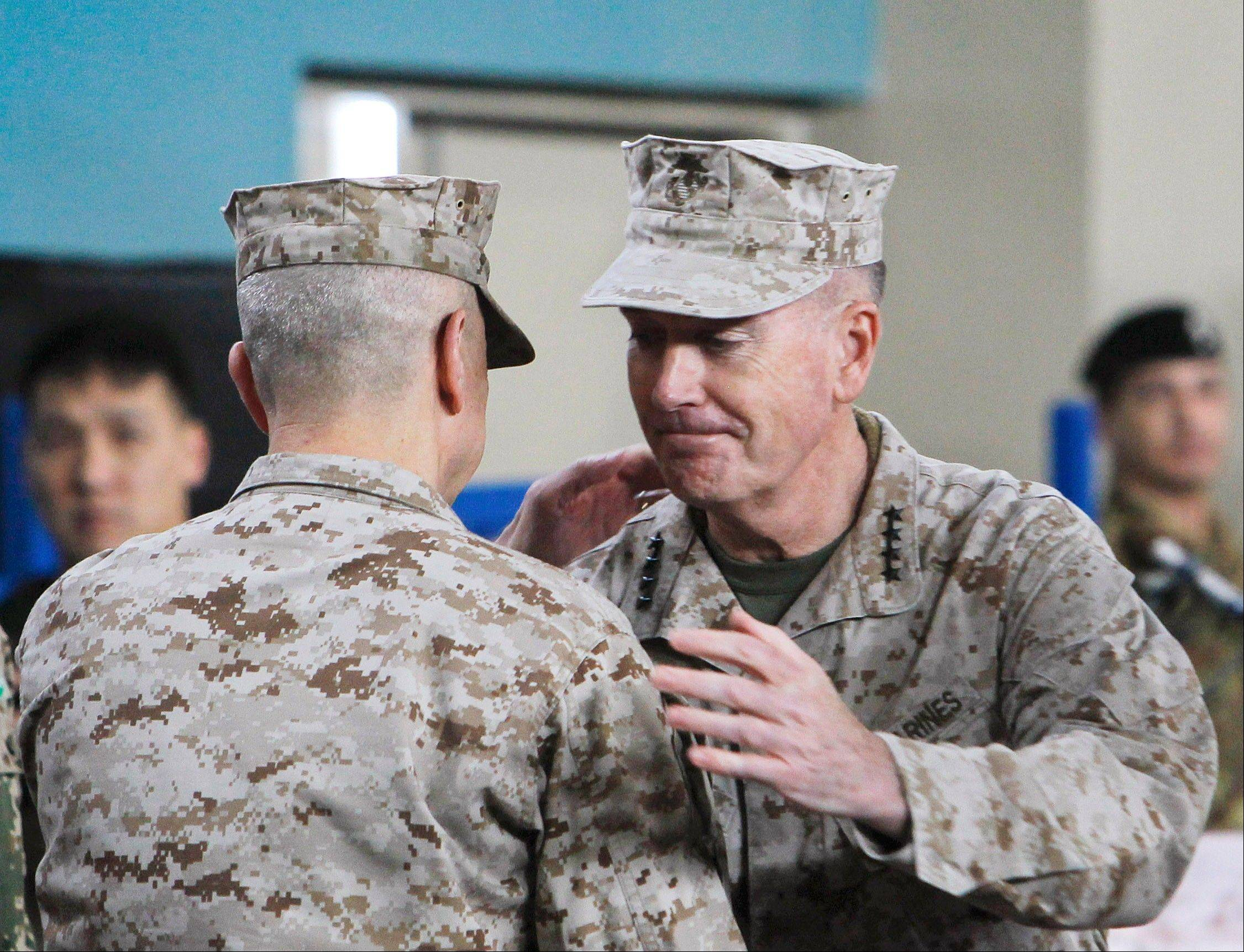 Associated PressGen. Joseph Dunford, right, hugs the outgoing commander, Gen. John Allen, on Sunday during a change-of-command ceremony in Kabul, Afghanistan.