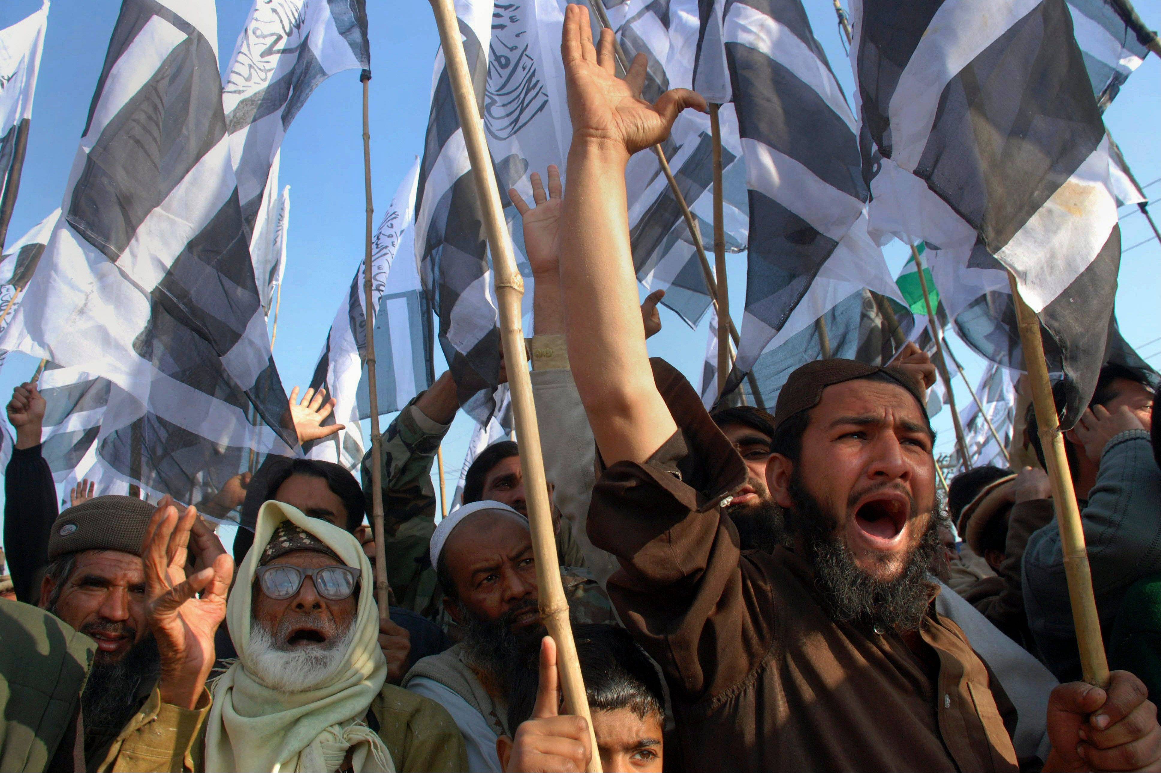 Supporters of the Pakistani religious group Jamat-ud-Dawa chant slogans during a demonstration Sunday to condemn the hanging of Mohammed Afzal Guru in Rawalpindi, Pakistan.