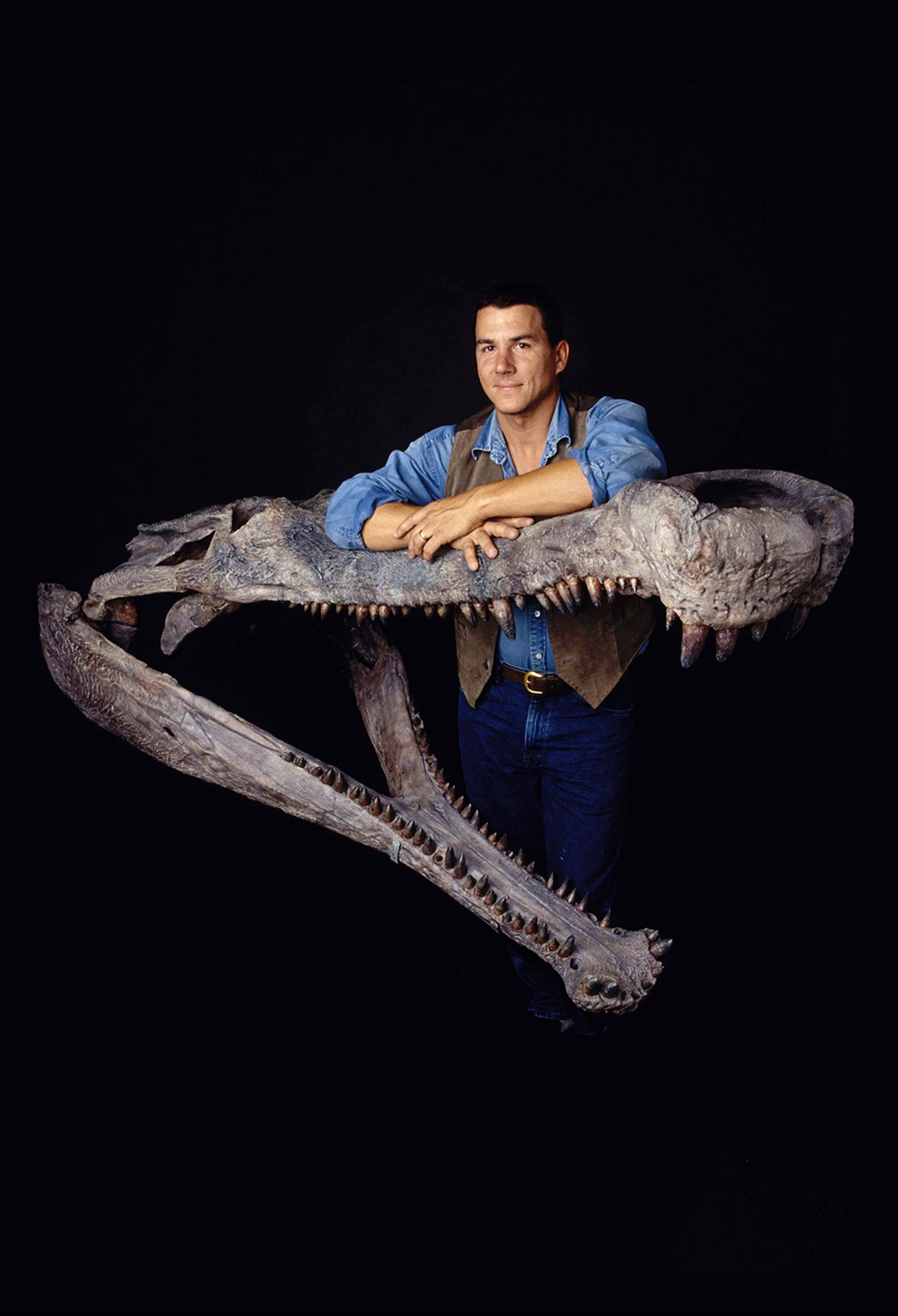Paul Sereno, co-founder of Project Exploration based in Chicago, stands with the original 110-million-year-old fossil skull of SuperCroc. The exhibit featuring 40-foot crocodiles is headed in early May to Gail Borden Public Library in Elgin.