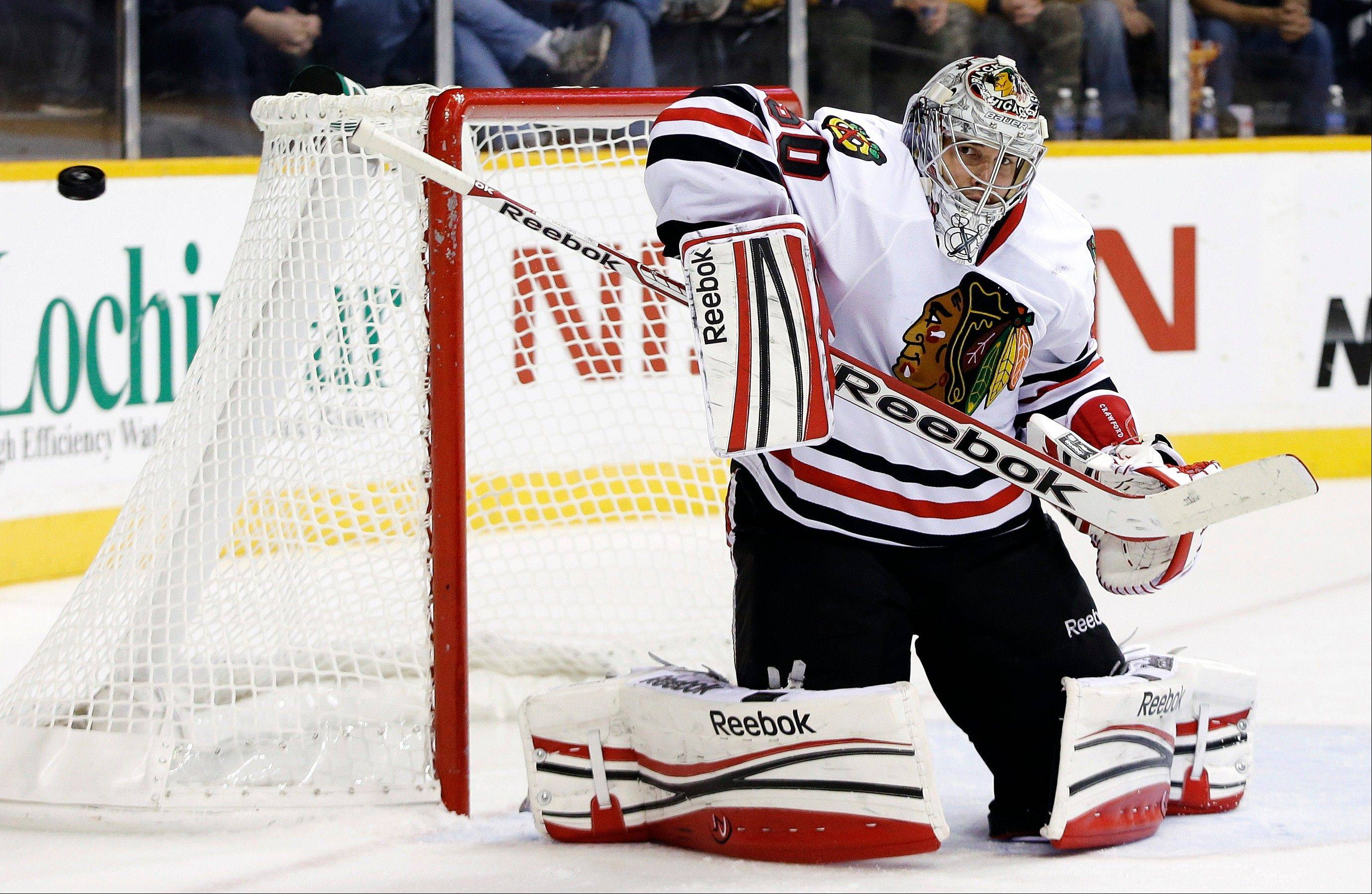 Chicago Blackhawks goalie Corey Crawford blocks a shot against the Nashville Predators in the second period of an NHL hockey game, Sunday, Feb. 10, 2013, in Nashville, Tenn.