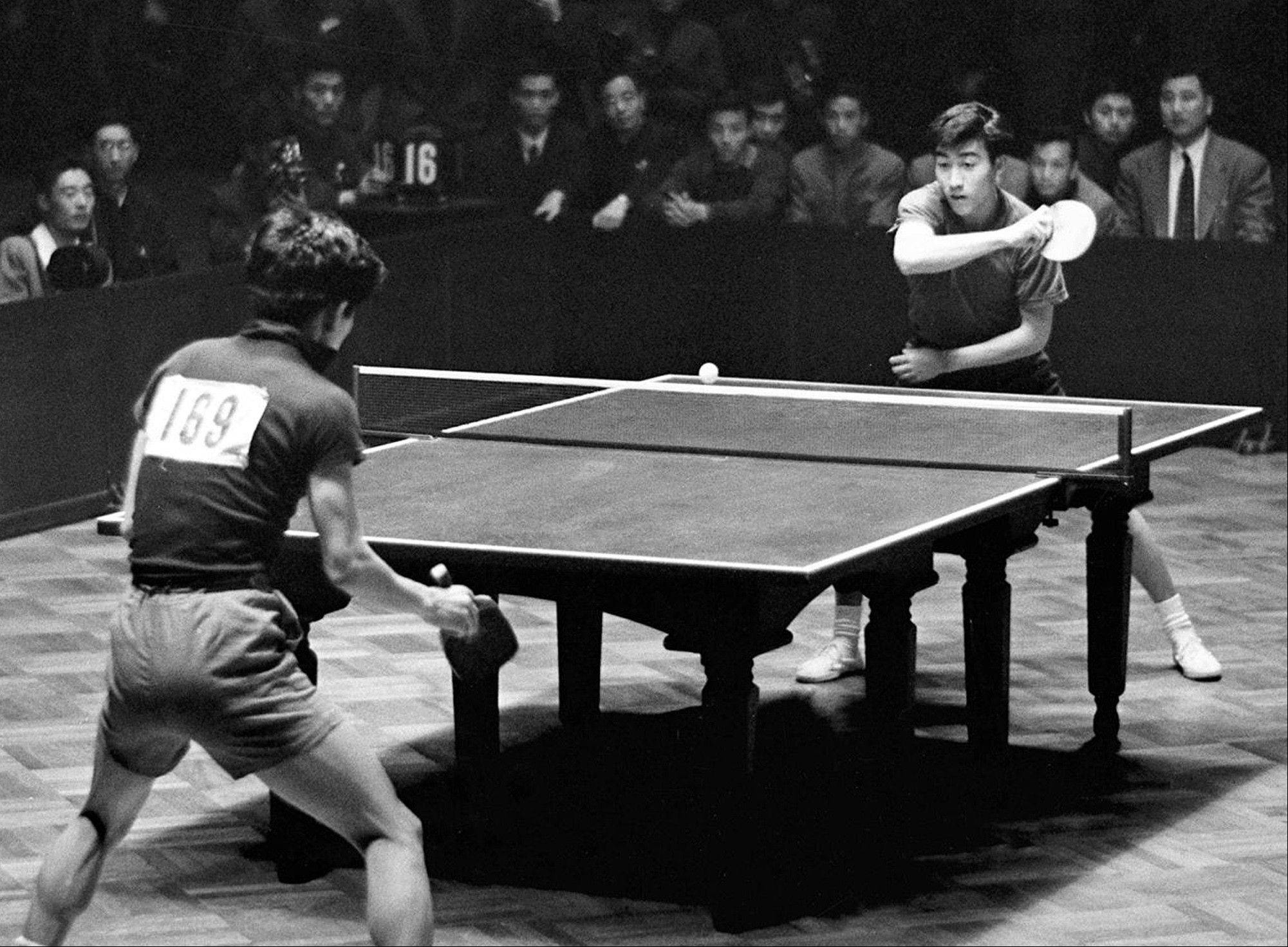 Zhuang Zedong, right, competes in the men's team finals of the 26th World Table Tennis Championship in Beijing in 1961.