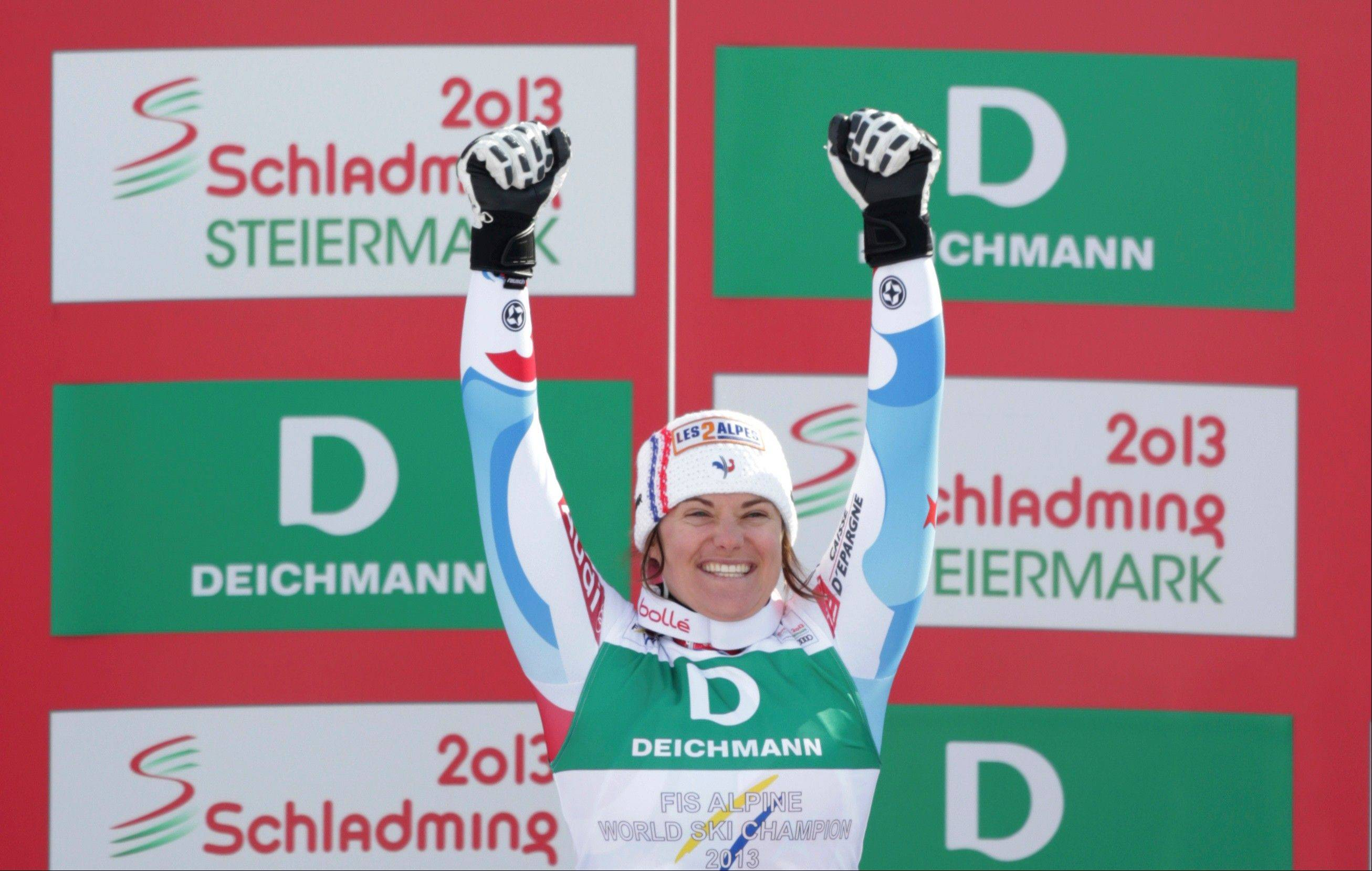 France's Marion Rolland celebrates winning gold in the women's downhill Sunday at the Alpine skiing world championships in Schladming, Austria.