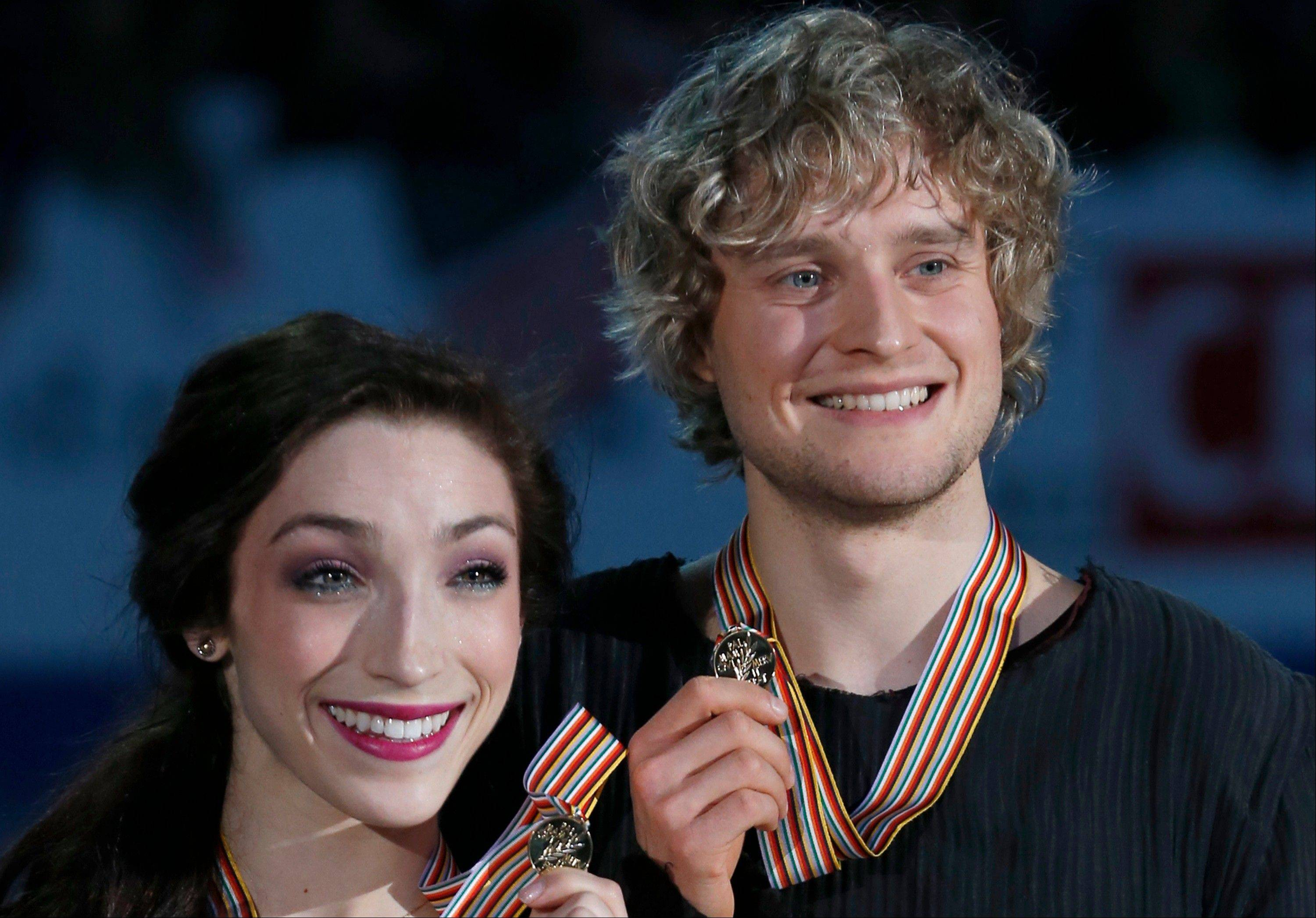Meryl Davis and Charlie White of U.S. pose for photographers on Sunday after winning the ice dance event at the ISU Four Continents Figure Skating Championships in Osaka, Japan.
