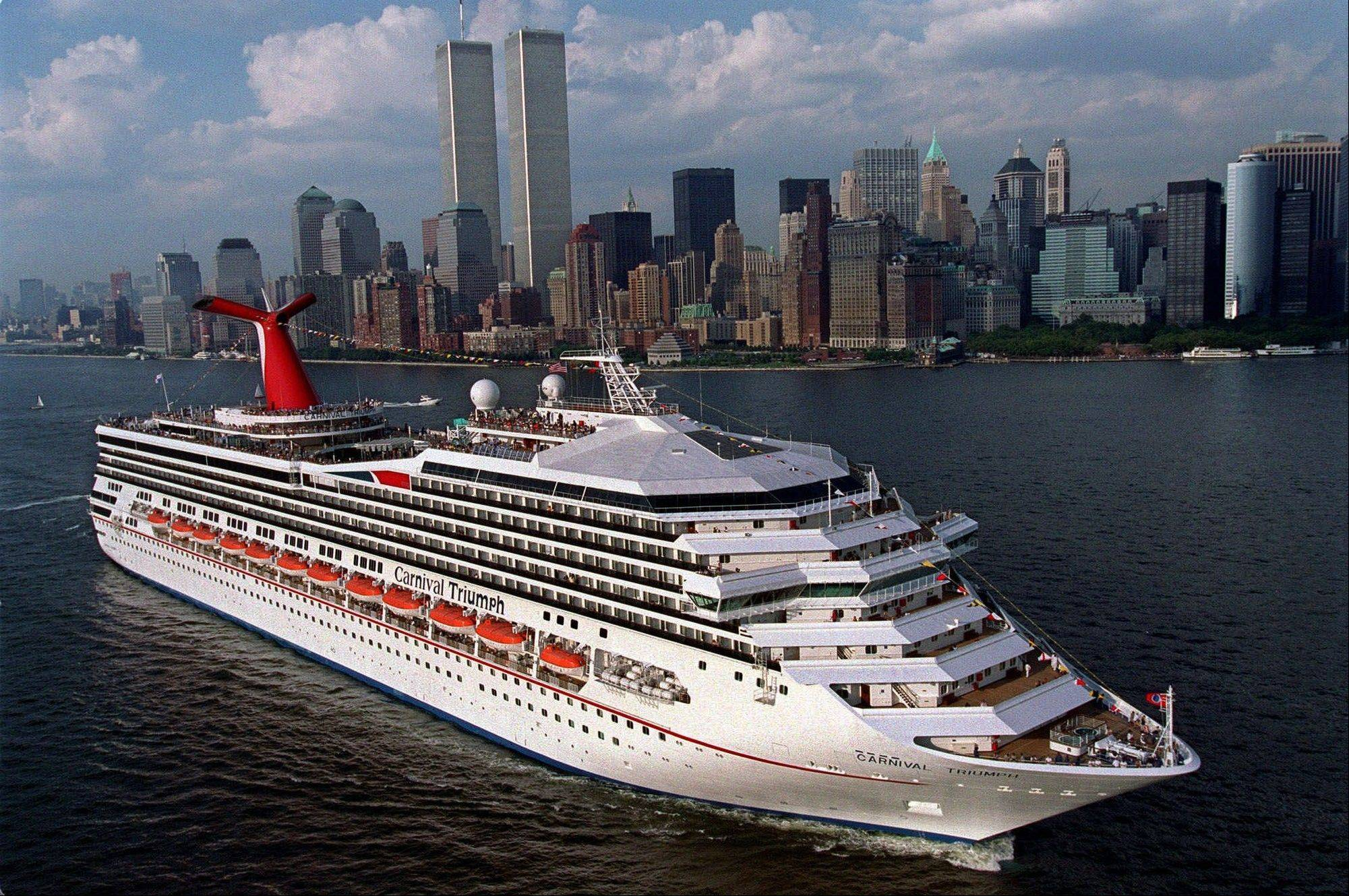 The MS Carnival Triumph is seen departing New York harbor on her inaugural voyage in 1999. Carnival Cruise Lines said Sunday an engine room fire had disabled the cruise ship about 150 miles off the Yucatan Peninsula with 3,143 passengers and 1,086 crew members on board.