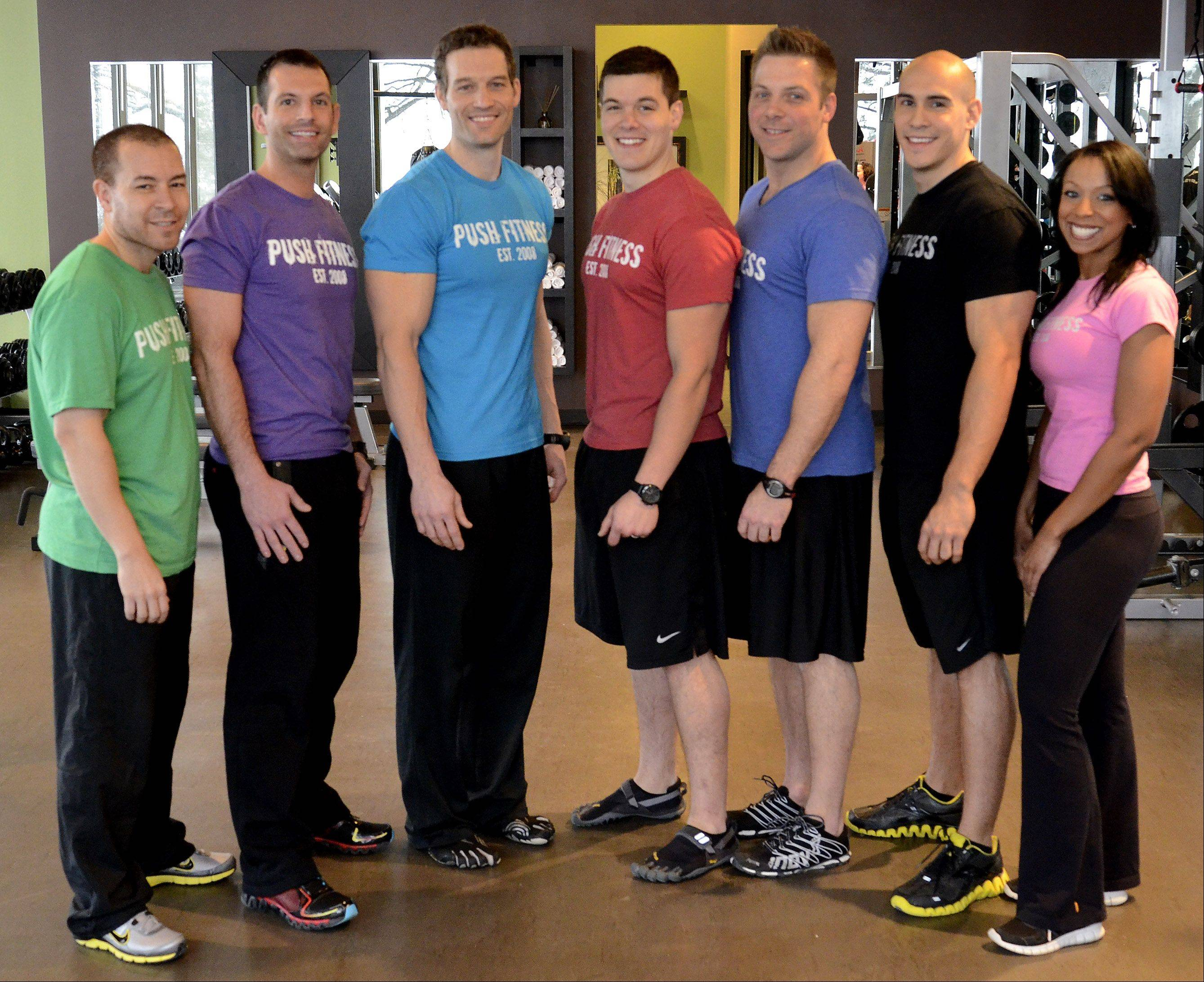 Training this year's Fittest Losers are Push Fitness personal trainers: Tony Figueroa, left, Steve Amsden, Joshua Steckler, Wade Merrill, Brodie Medlock, Tony Rinehart and Michelle Amsden.