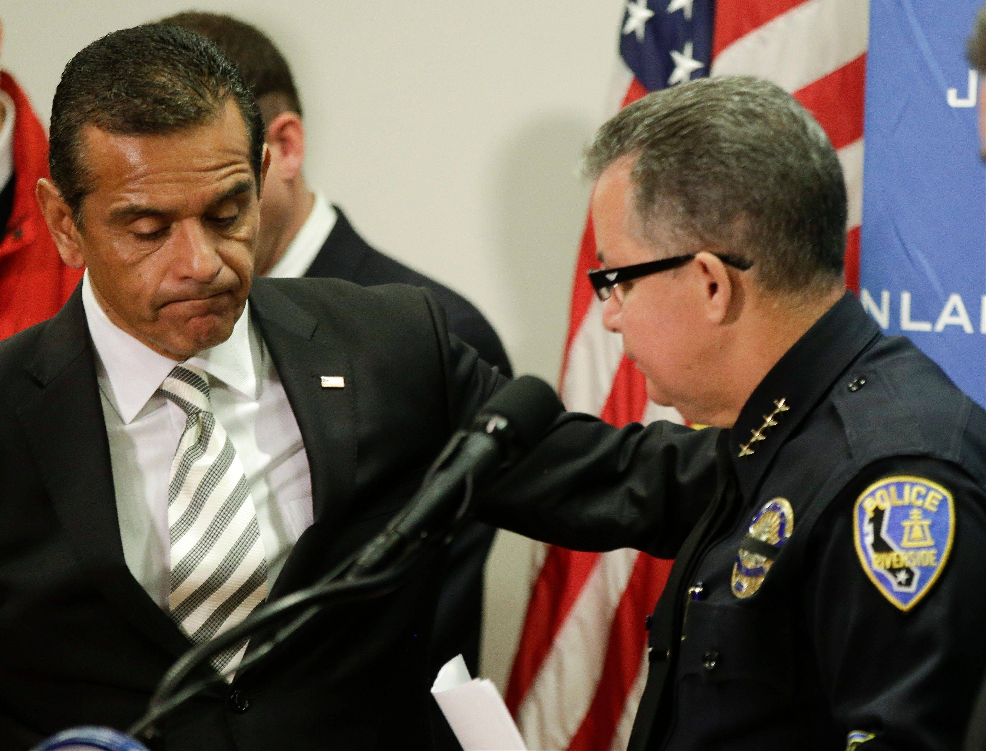Los Angeles Mayor Antonio Villaraigosa, left, comforts Riverside Police Chief Sergio Diaz Sunday after Diaz announced funeral plans for Riverside Police officer Michael Crain, who authorities say was killed by fired Los Angeles police officer Christopher Dorner.