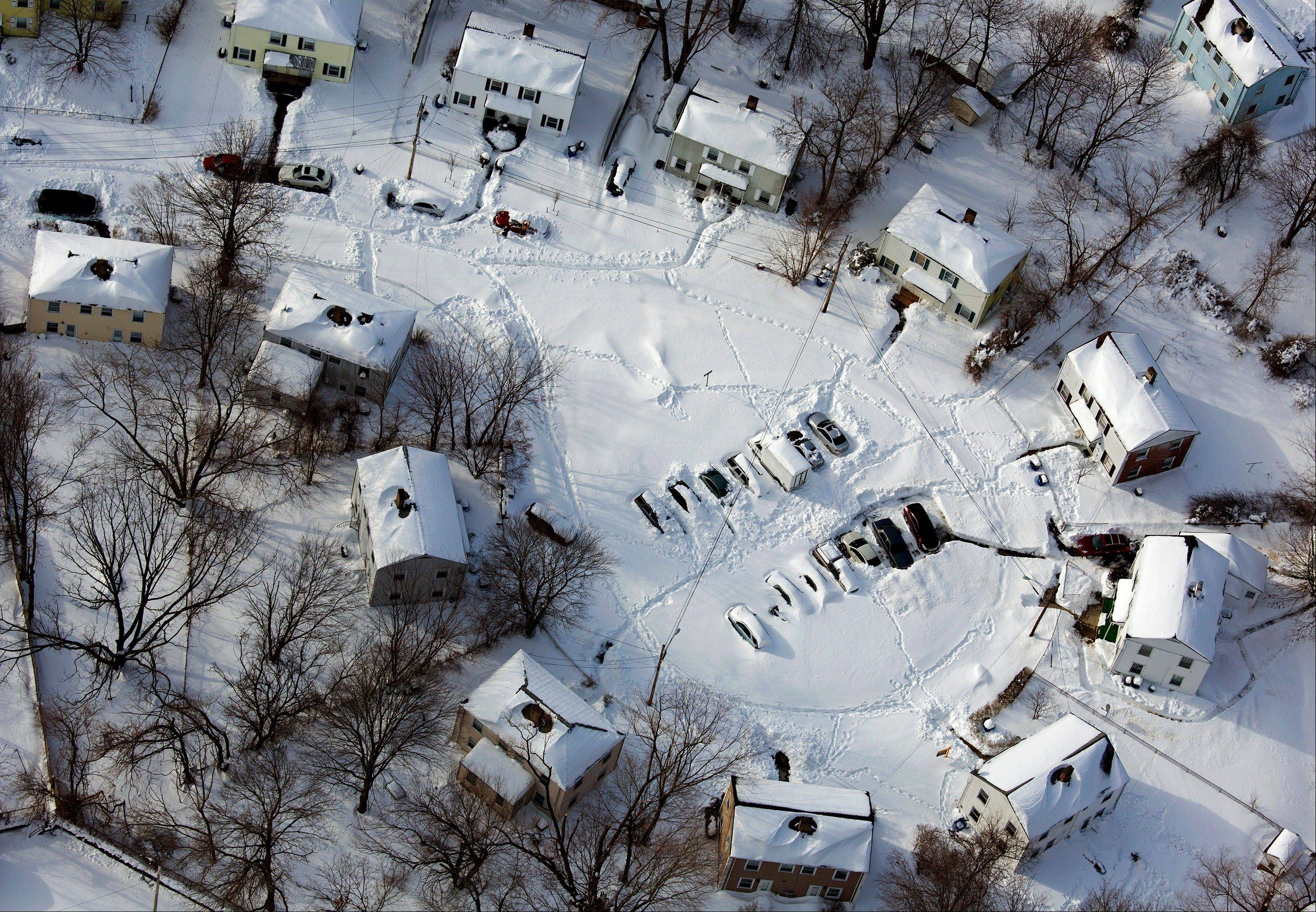 A neighborhood near New Haven, Conn., is buried in snow Sunday in the aftermath of a storm that hit Connecticut and much of New England Friday and early Saturday morning.