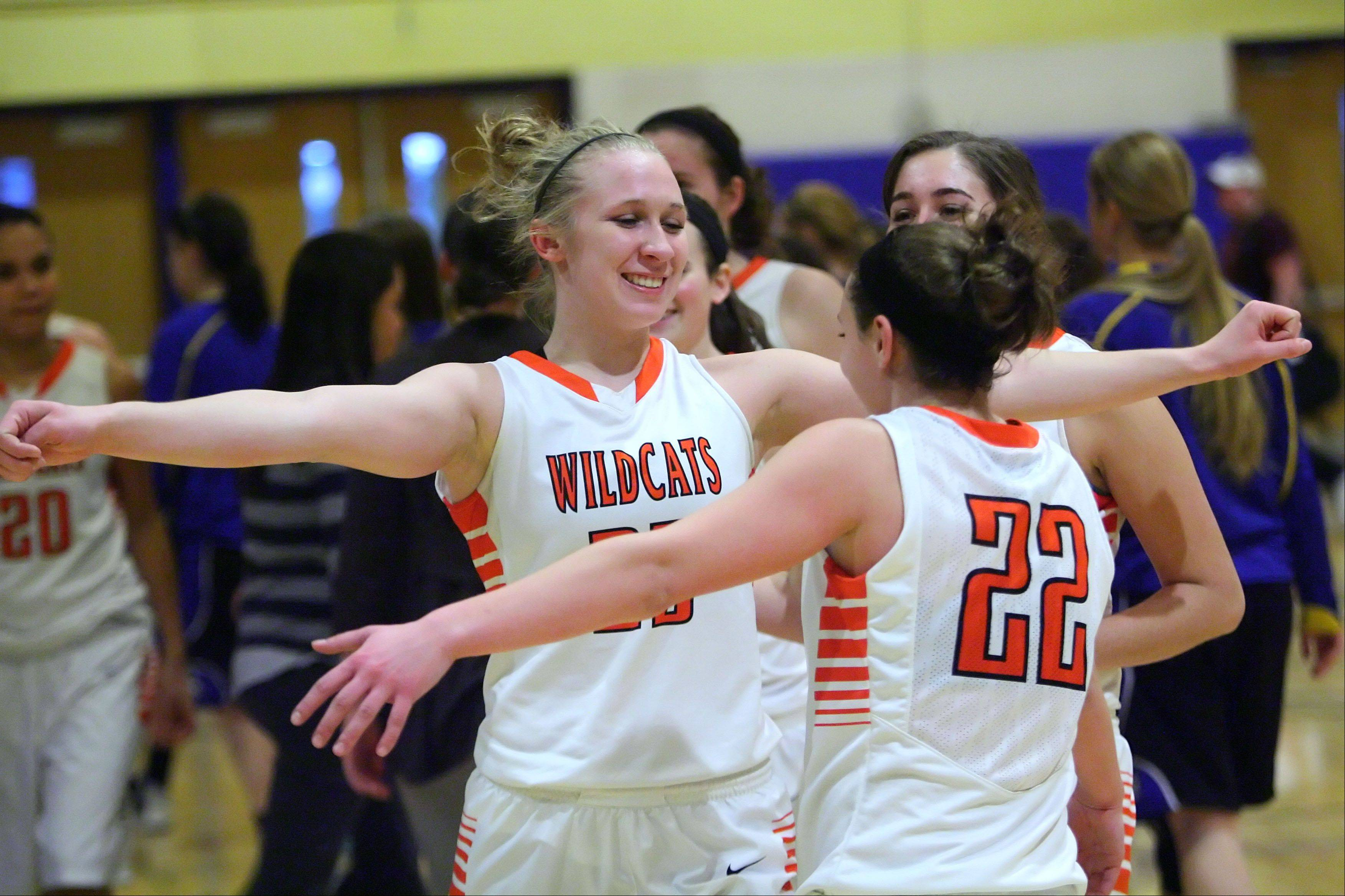 Libertyville�s Dana Kym, left, and Olivia Mayer celebrate after beating Wheeling.