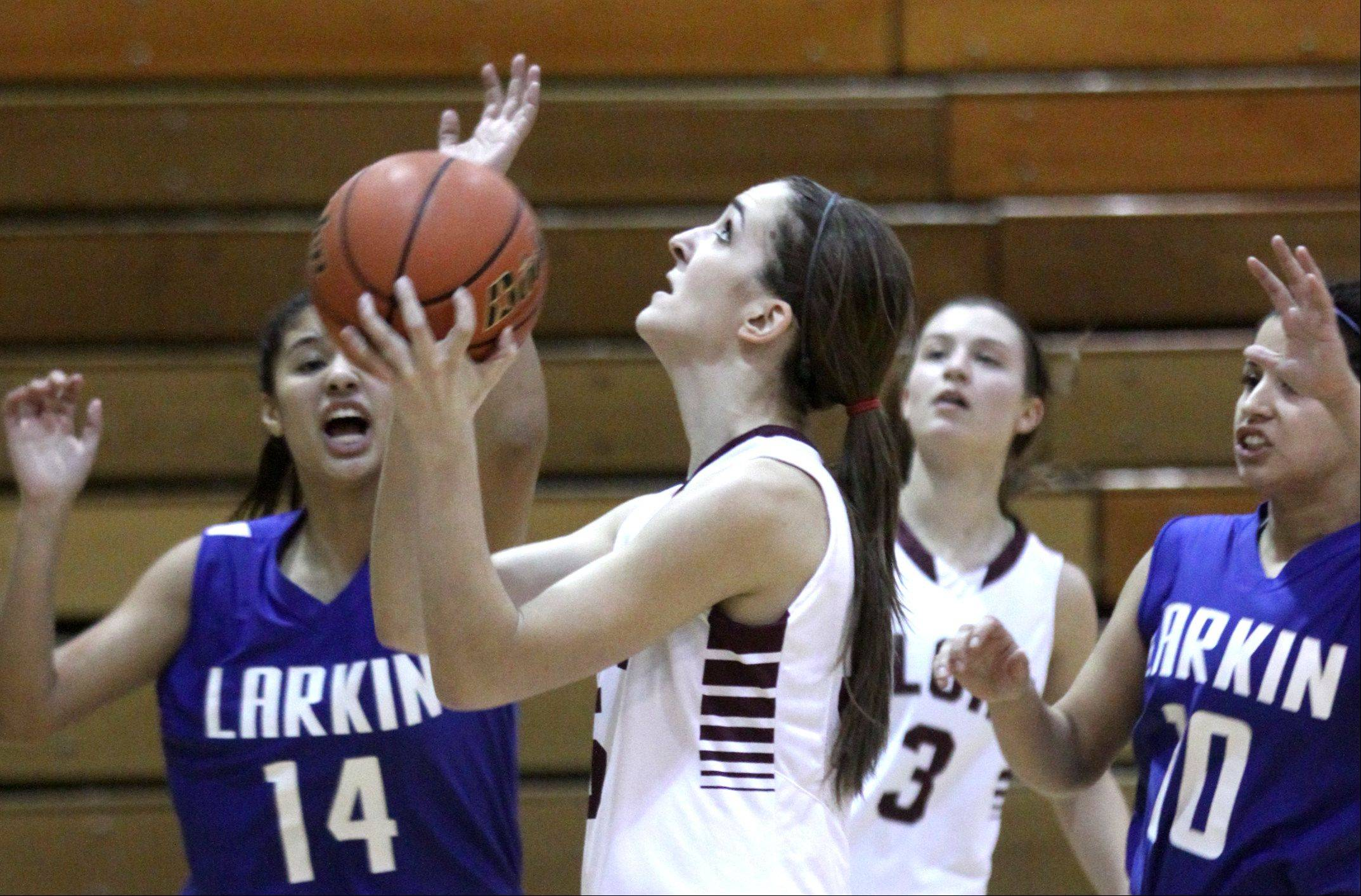 Elgin�s Tamara Milosevic, center, takes a shot against Larkin.