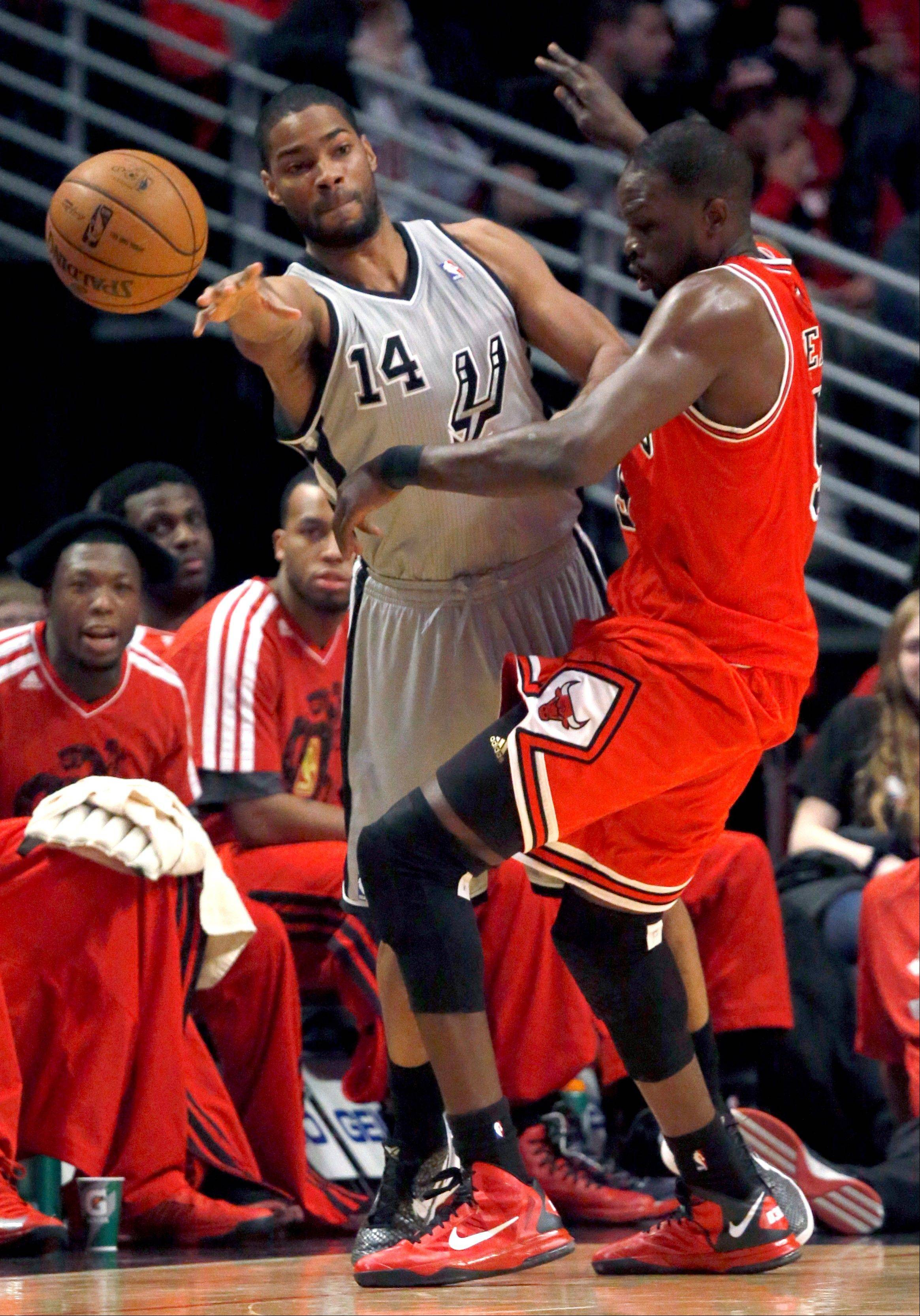 San Antonio Spurs guard Gary Neal (14) passes the ball past Chicago Bulls forward Luol Deng during the first half of an NBA basketball game, Monday, Feb. 11, 2013, in Chicago. (AP Photo/Charles Rex Arbogast)