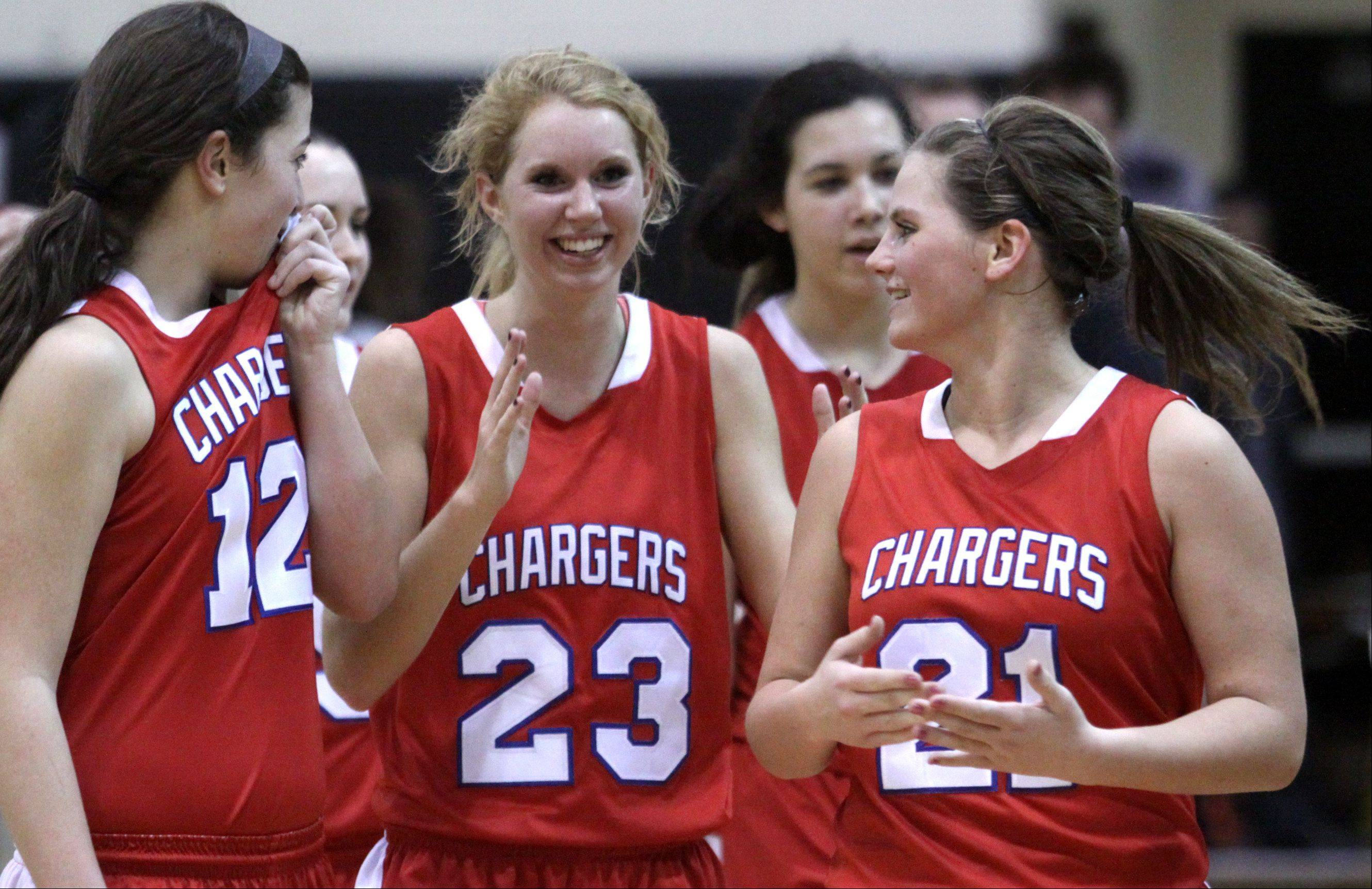 From left, Dundee-Crown�s Lauren Lococo, Jillian Weichmann, and Stephanie Magsamen are all smiles after beating Jacobs.