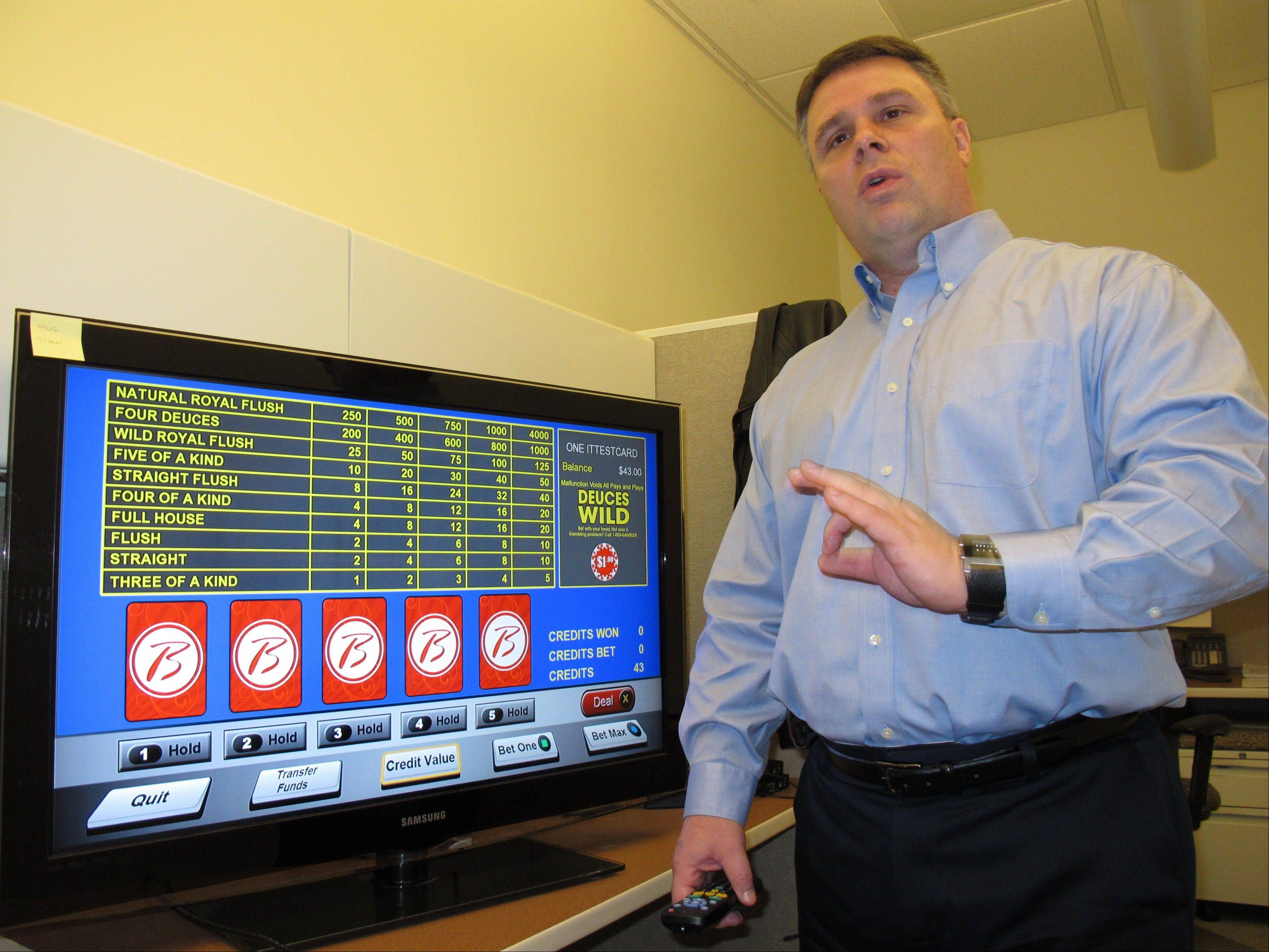 John Forelli, a vice presicent at the Borgata Hotel Casino & Spa in Atlantic City, demonstrates a new in-room gambling system Monday. The casino says it is the first in the nation to offer this technology.