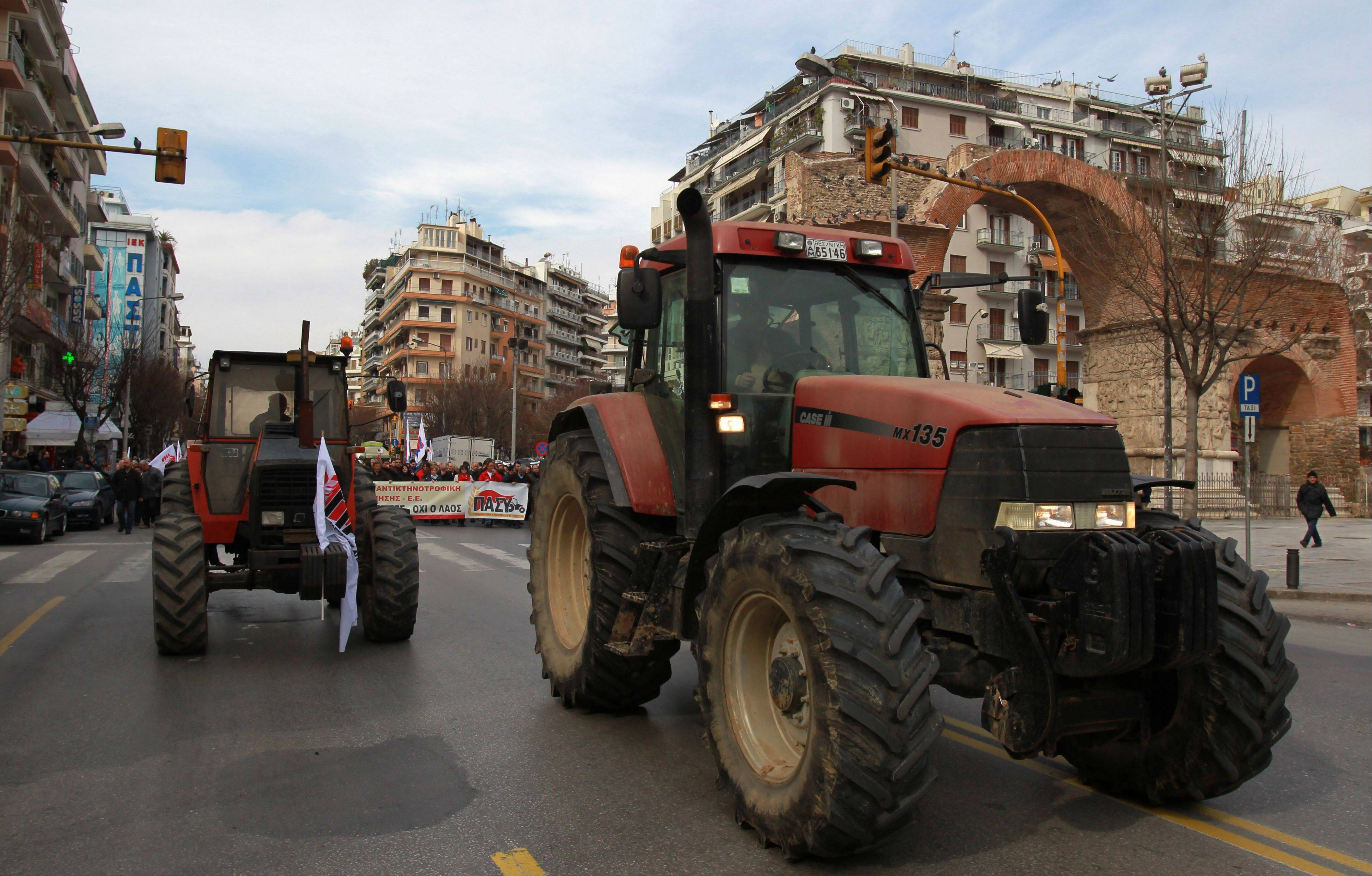 Farmers affiliated with the communist party drive their tractors through city center Saturday during a protest in the northern city of Thessaloniki Greece. Farmers complain that their production costs are too high, and want Greece's conservative-led coalition government to reduce the price of fuel, scrap plans to increase taxation on agriculture and cut sales tax on their goods.