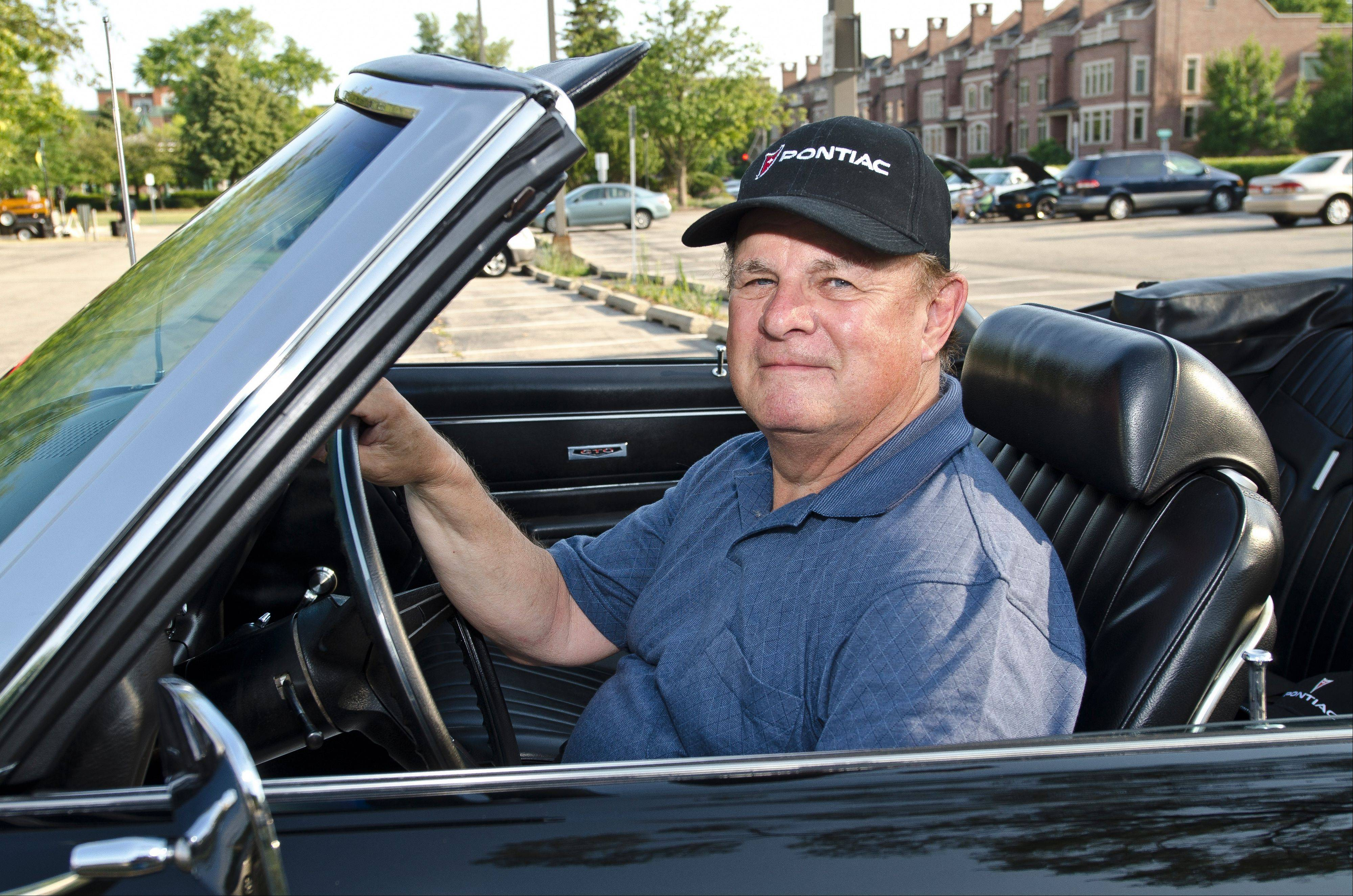 Jerry Bertram of Palatine prefers the drive of older automobiles to today's modern vehicles.