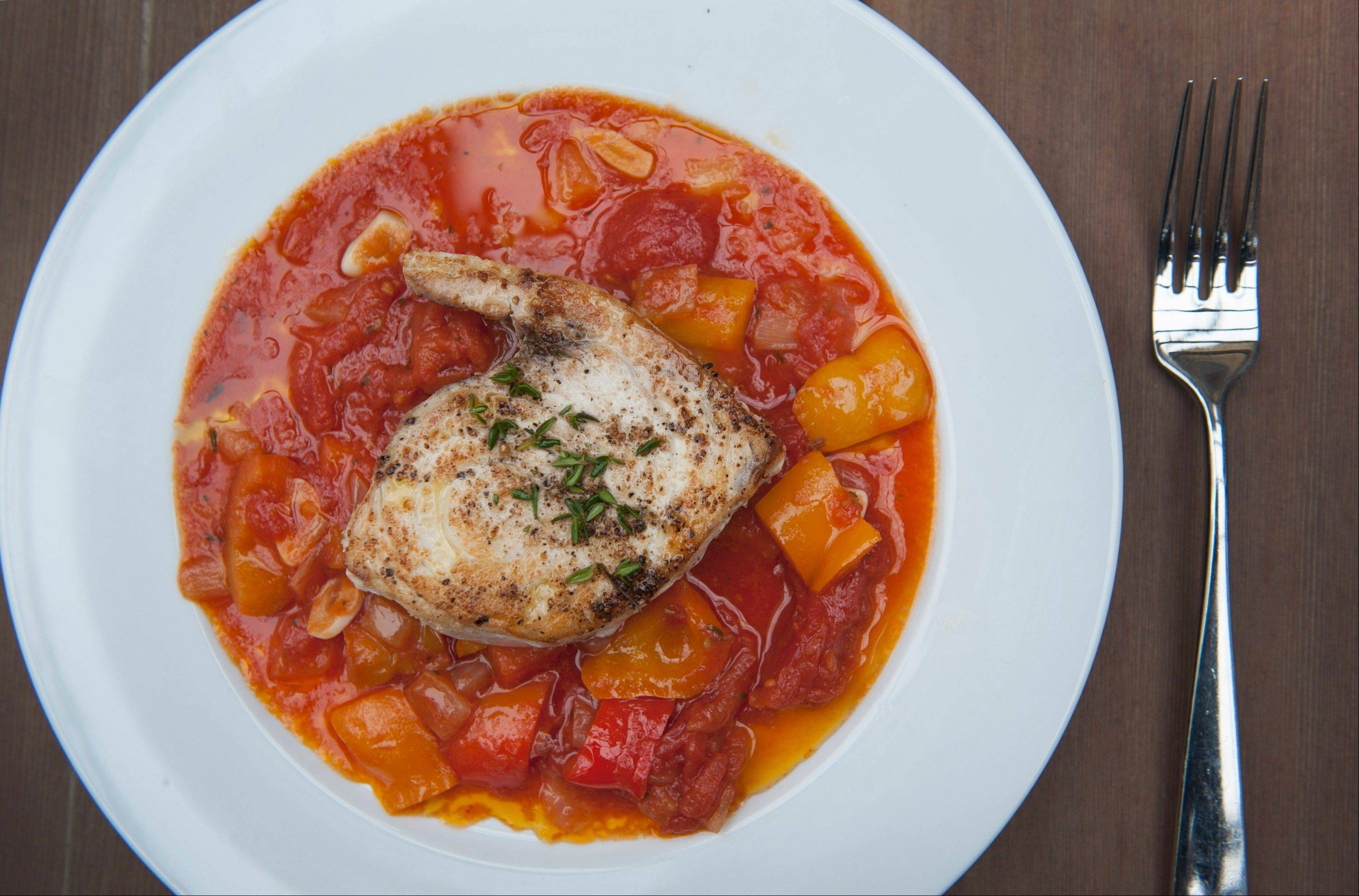 Pan-Seared Swordfish Steaks With Orange Piperade. Piperade is a Basque tomato and pepper stew.