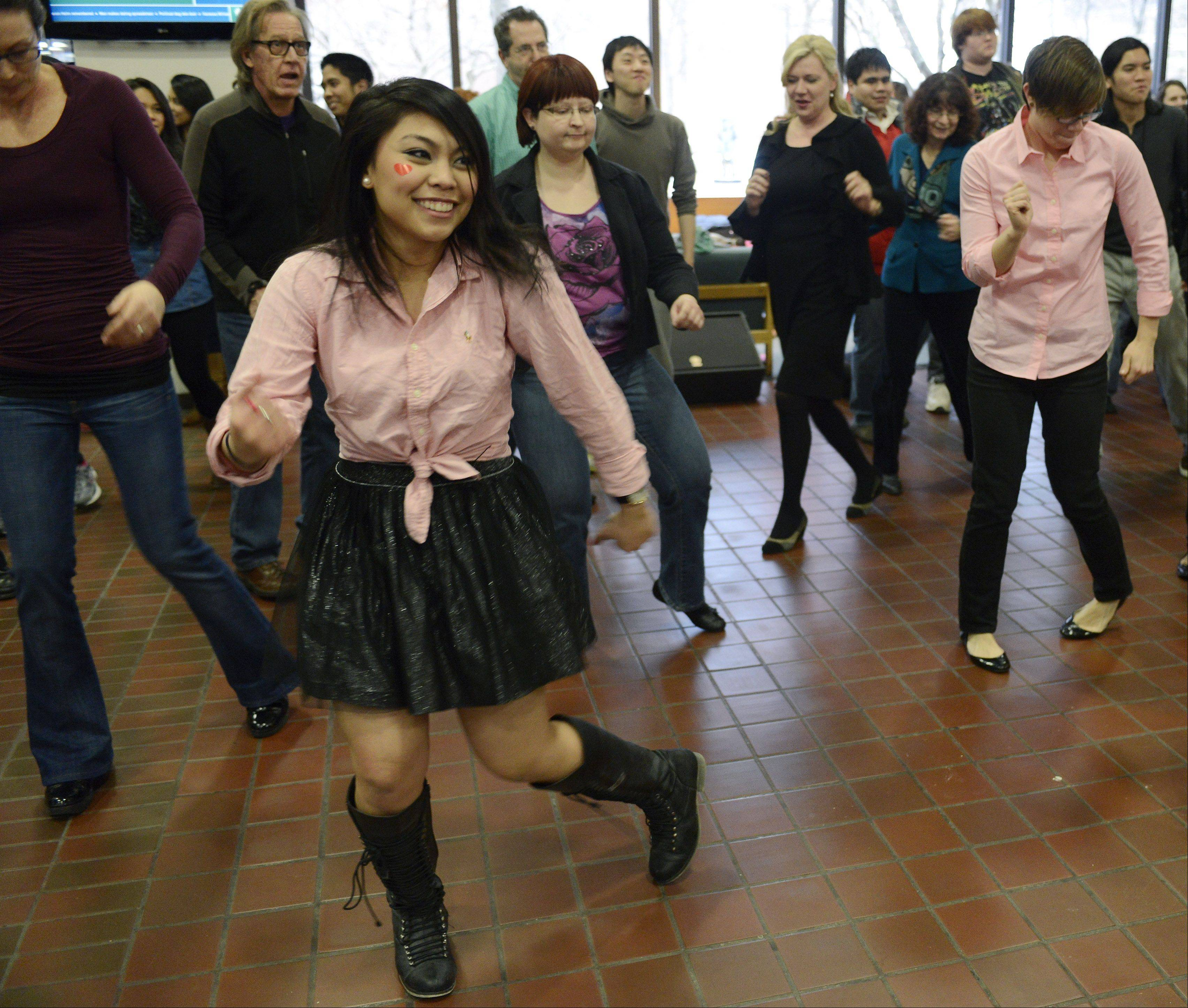 Cristine De Clarin of Niles participates in a group dance during a One Billion Rising event to raise awareness about violence against women, sponsored by the Women and Gender Studies program at Oakton Community College in Des Plaines Thursday.