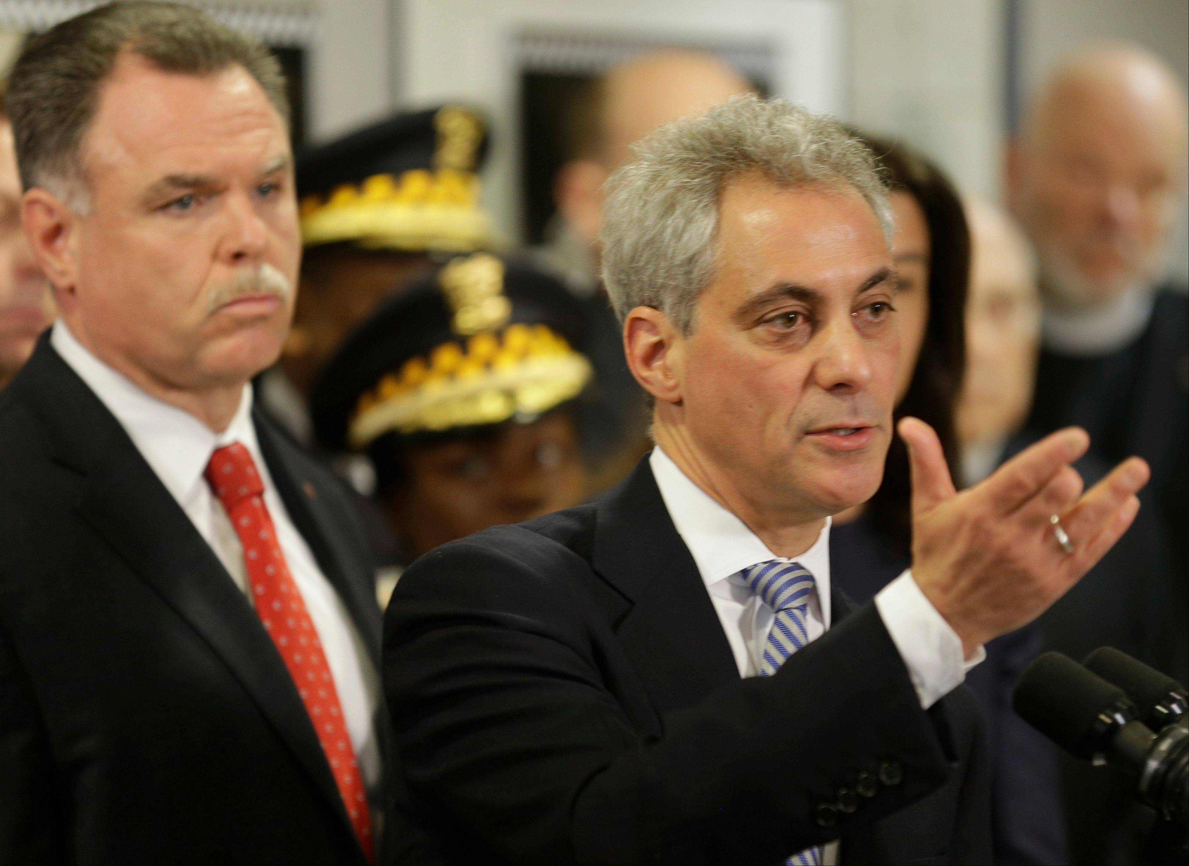 Chicago Mayor Rahm Emanuel and Chicago Police Superintendent Garry McCarthy discuss gun violence at a news conference Monday in Chicago. During the news conference McCarthy, Emanuel and Cook County State's Attorney Anita Alvarez said they will push for state legislation that increases the minimum sentences for those who violate the state's gun laws.