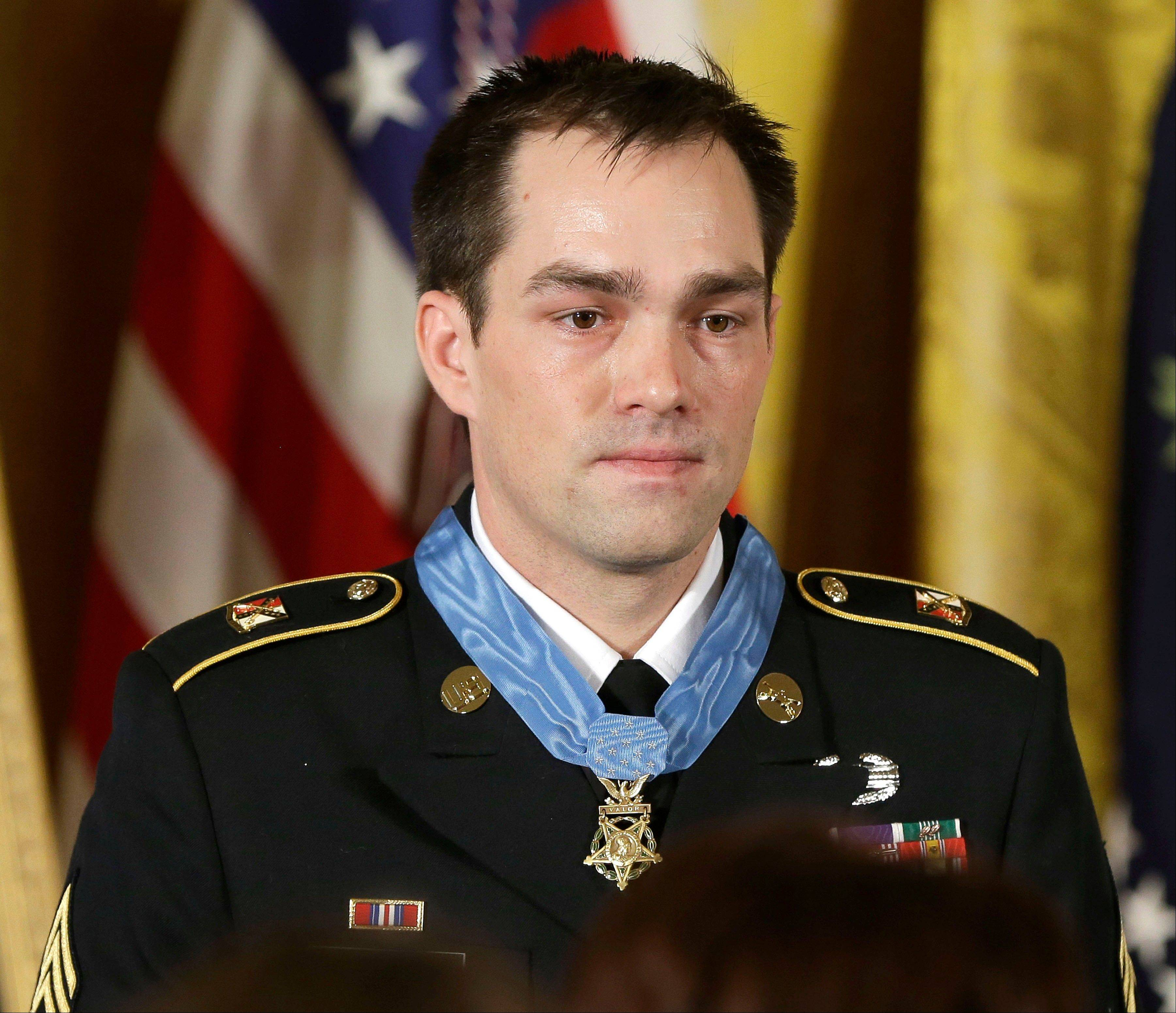 Medal of Honor recipient retired Staff Sgt. Clinton Romesha is seen onstage Monday during the ceremony in the East Room of the White House in Washington. Romesha's leadership during a daylong attack by hundreds of fighters on Combat Outpost Keating in Afghanistan led to award.