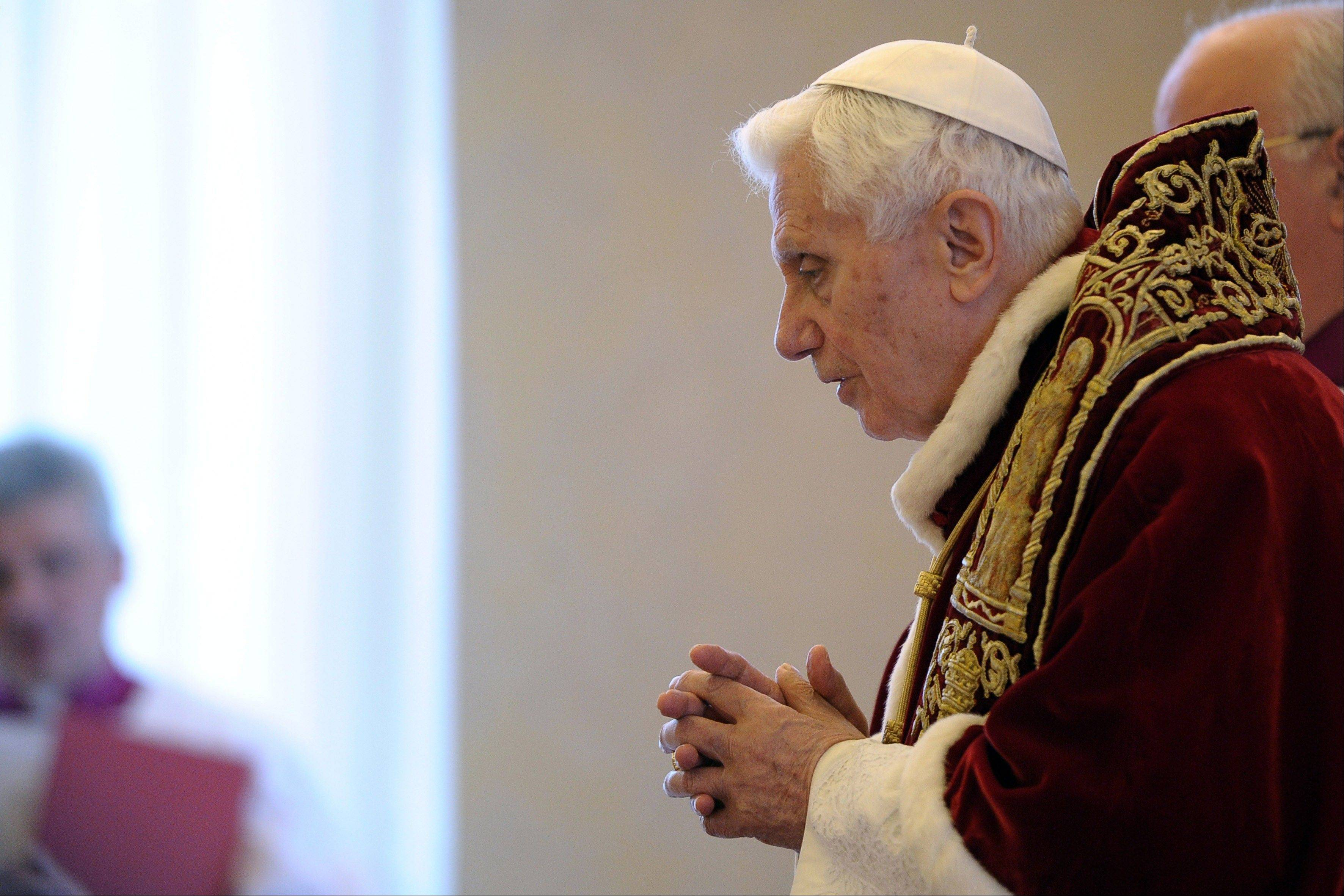 Pope Benedict XVI delivers his message Monday during a meeting of cardinals at the Vatican. Benedict XVI announced Monday that he would resign Feb. 28 -- the first pontiff to do so in nearly 600 years. The decision sets the stage for a conclave to elect a new pope before the end of March.