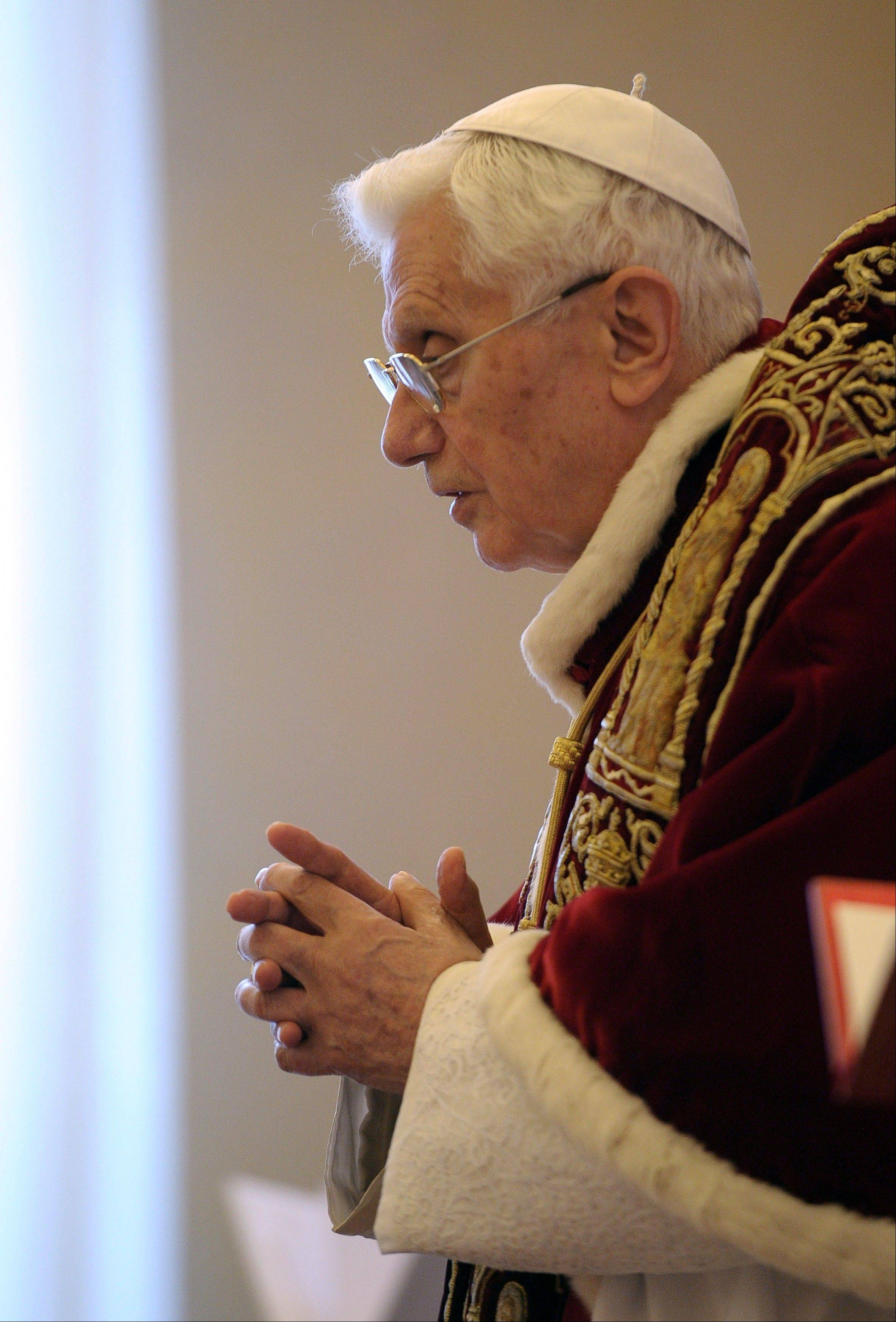 Pope Benedict XVI delivers his message Monday at the end of a meeting of Vatican cardinals.