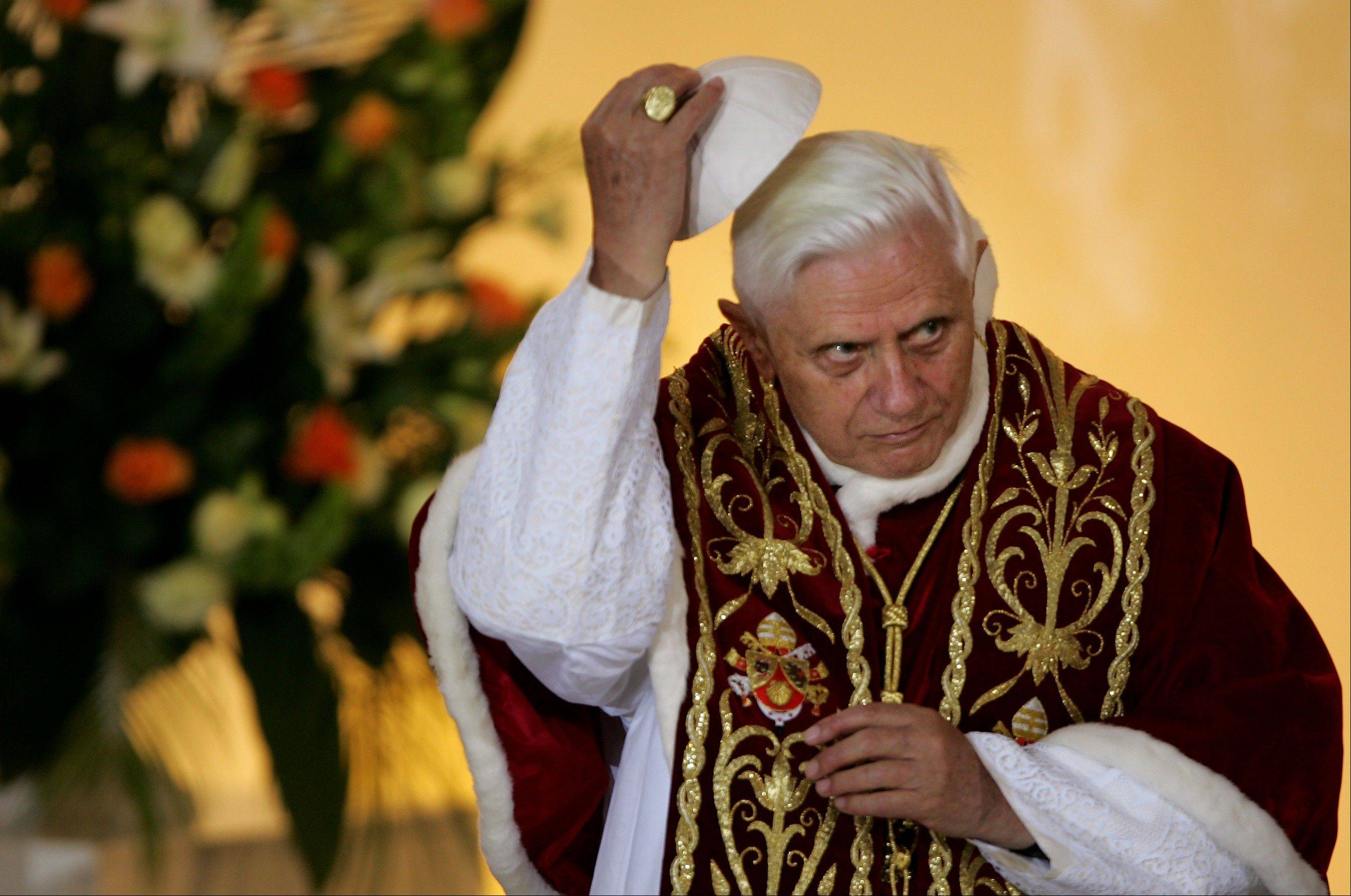 Pope Benedict XVI lifting his scull cap during an ecumenical meeting at the Holy Trinity church in Warsaw, Poland.