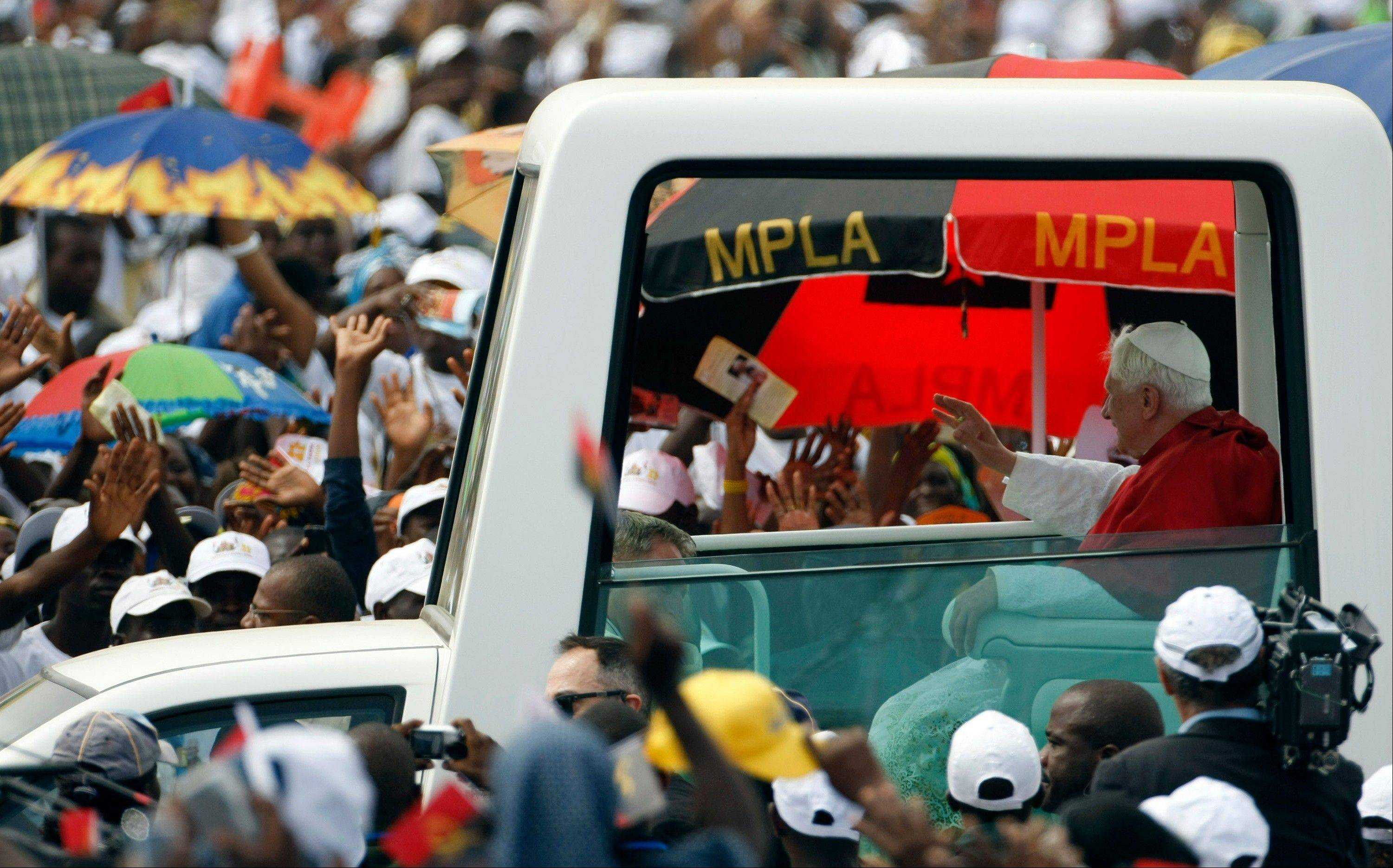Pope Benedict XVI arrives in the popemobile to celebrate a Mass on the outskirts of Angola's seaside capital, Luanda.