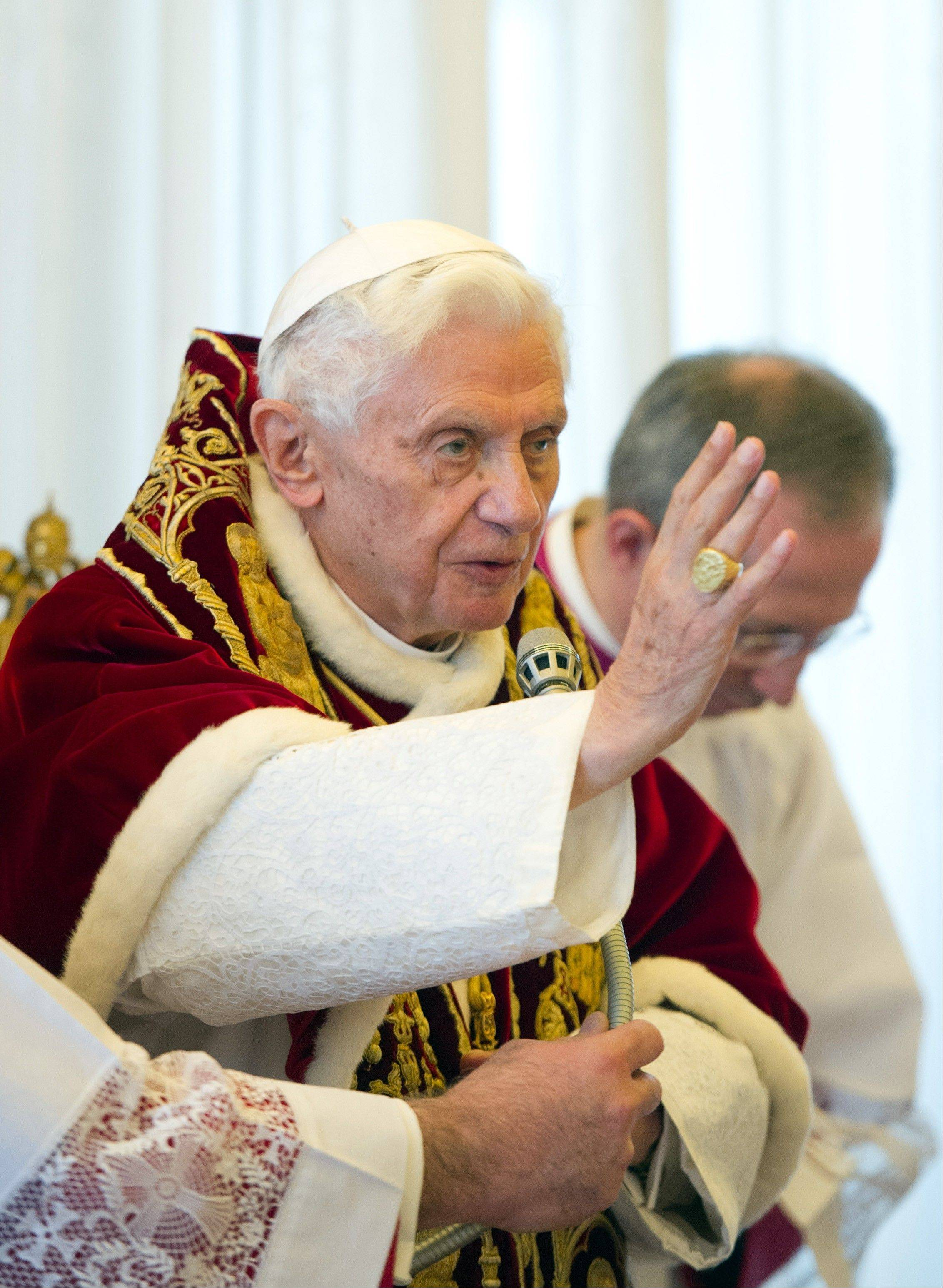 Pope Benedict XVI delivers his blessing Monday at the end of a meeting of Vatican cardinals.