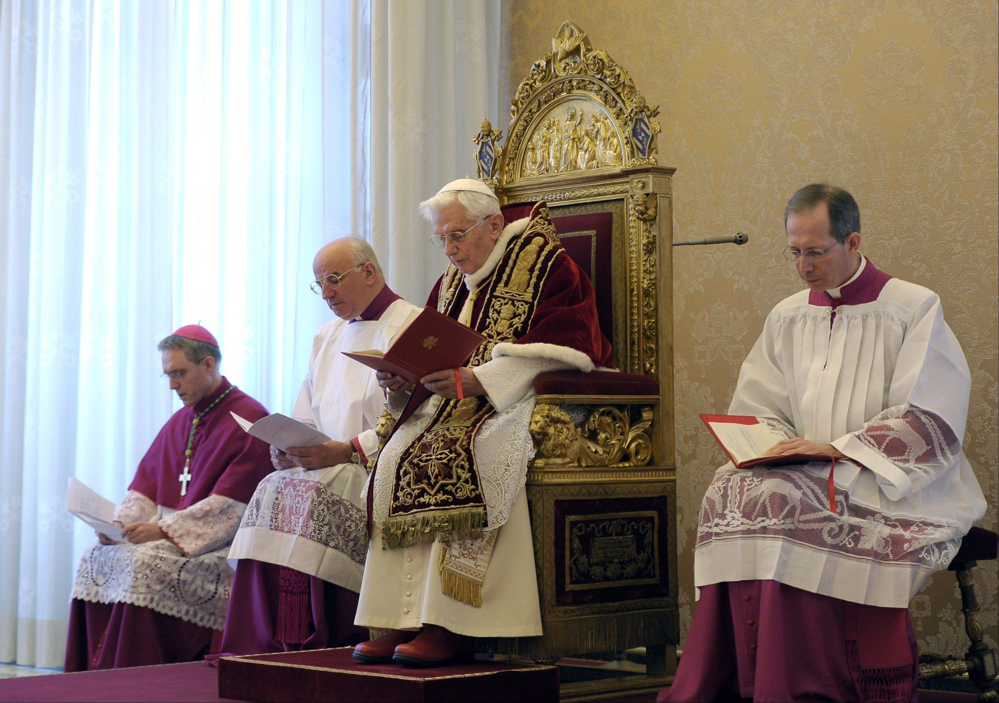 Pope Benedict XVI, third from left, delivers his message Monday at the end of a meeting of Vatican cardinals.