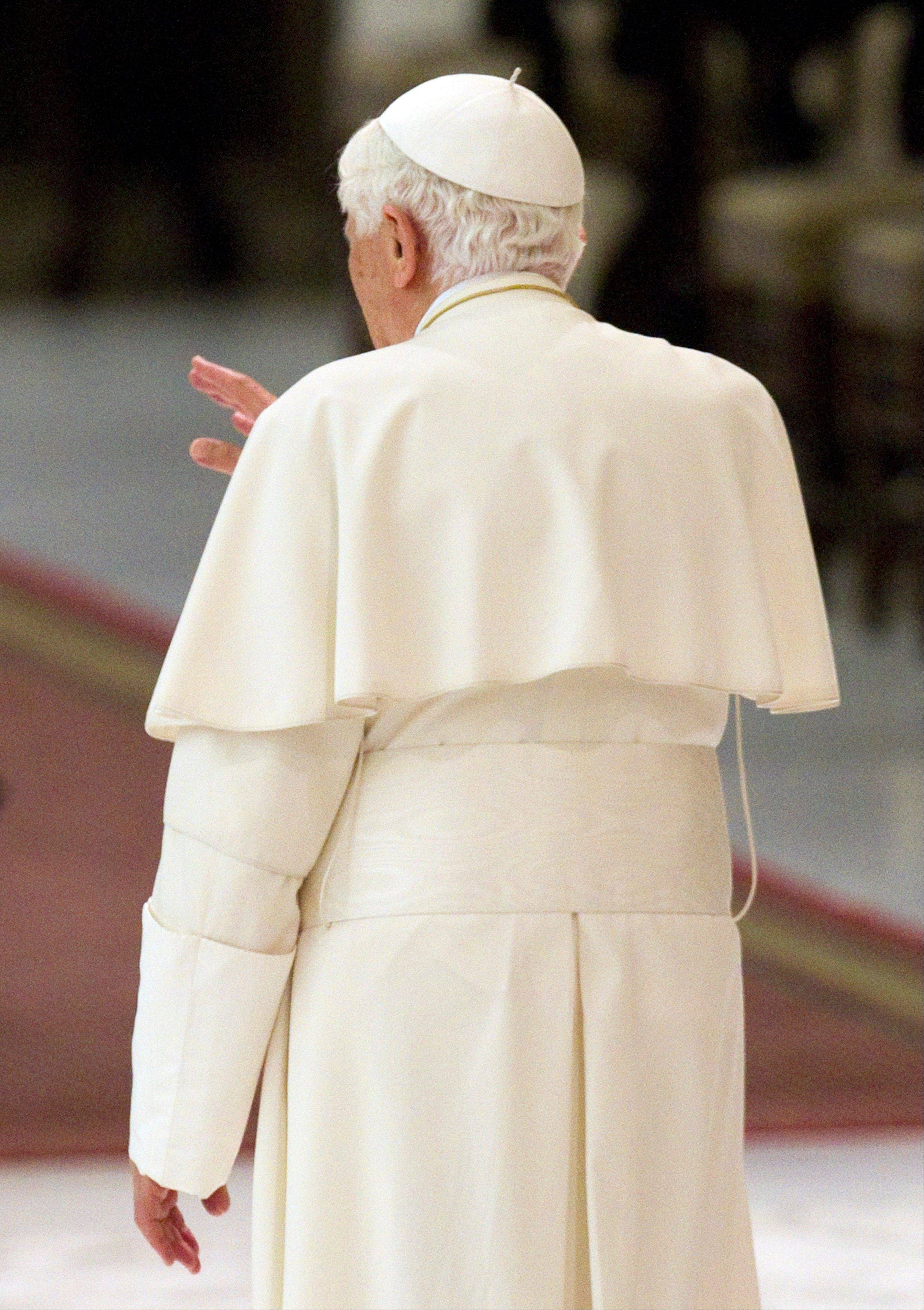 "Pope Benedict XVI leaves after a special audience he granted to members of the ""Sister Nature"" foundation in the Pope Paul VI hall at the Vatican."
