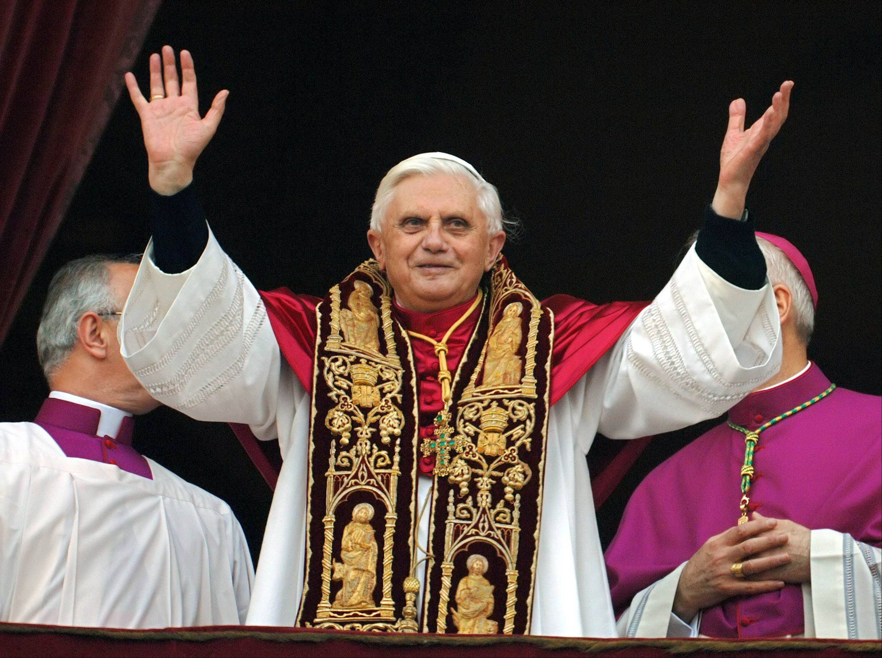Pope Benedict XVI greeting the crowd from the central balcony of St. Peter's Basilica moments after being elected at the Vatican.