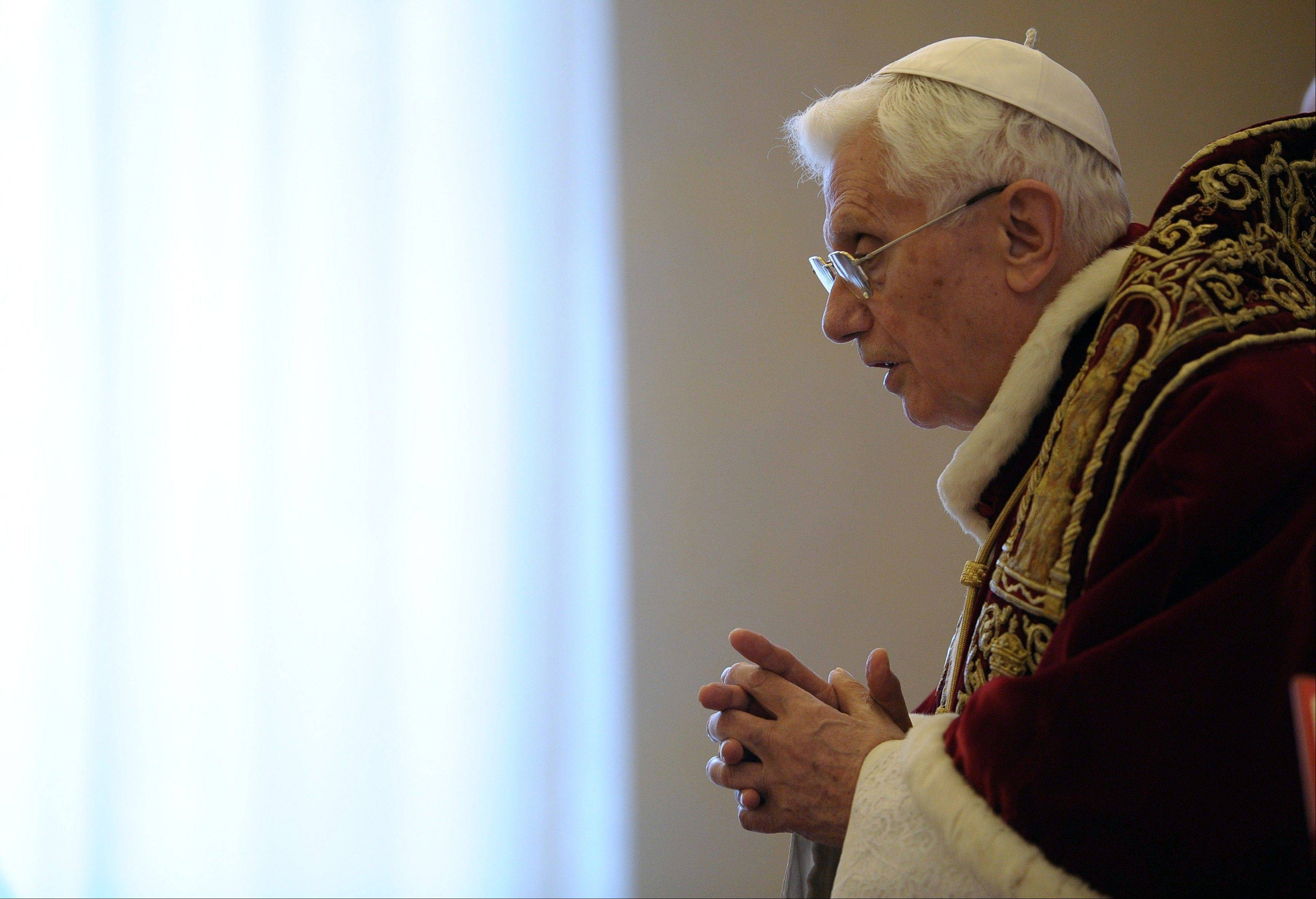 Pope Benedict XVI delivers his message Monday at the end of a meeting of Vatican cardinals at the Vatican.