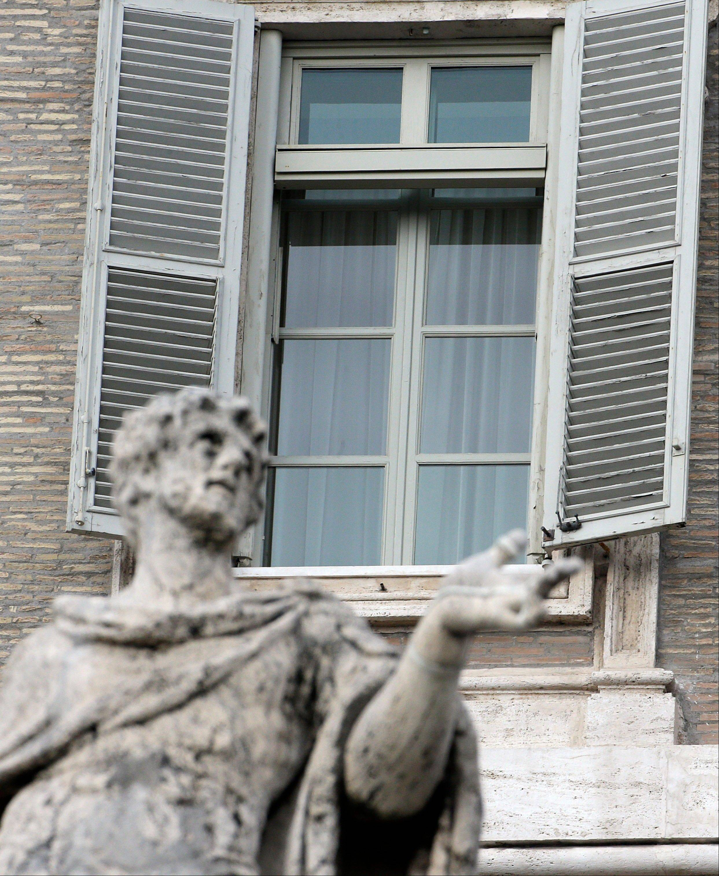 Pope Benedict XVI's studio window is seen framed by a statue at the Vatican.