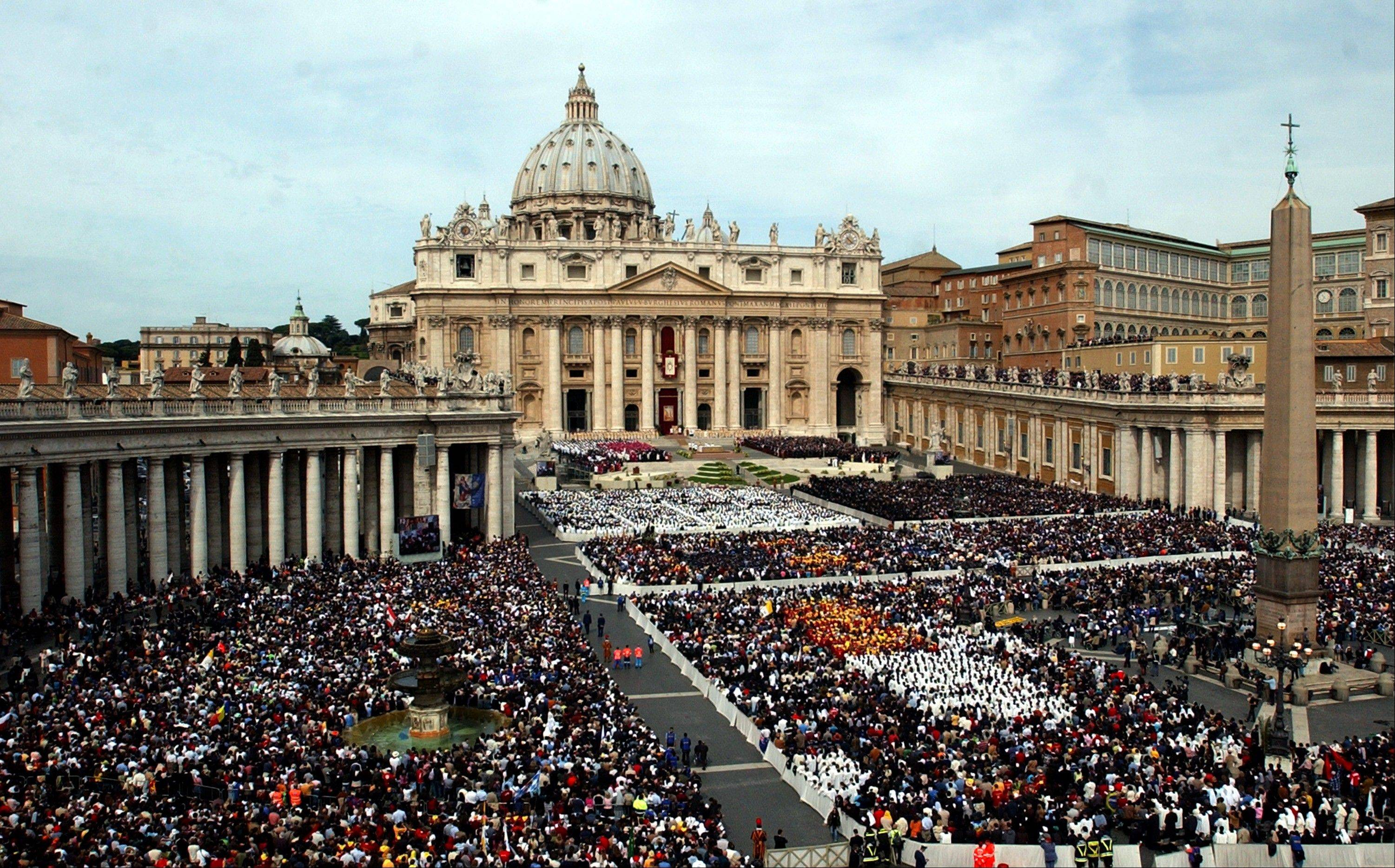 Thousands of people attend the installment Mass of Pope Benedict XVI in St. Peter's Square at the Vatican.