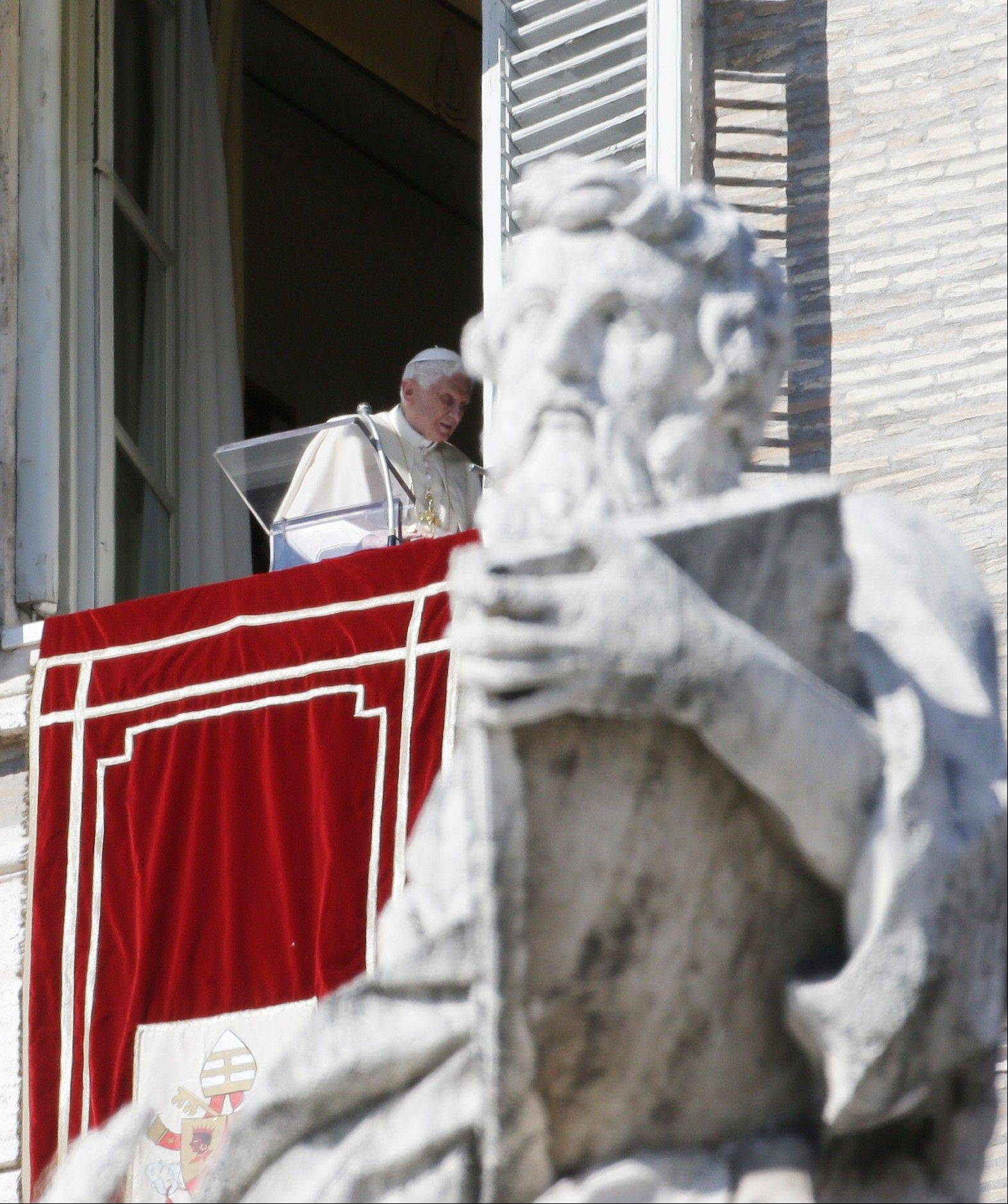 Pope Benedict XVI walks away from his studio window overlooking St. Peter's Square Sunday after delivering his Angelus noon prayer at the Vatican.